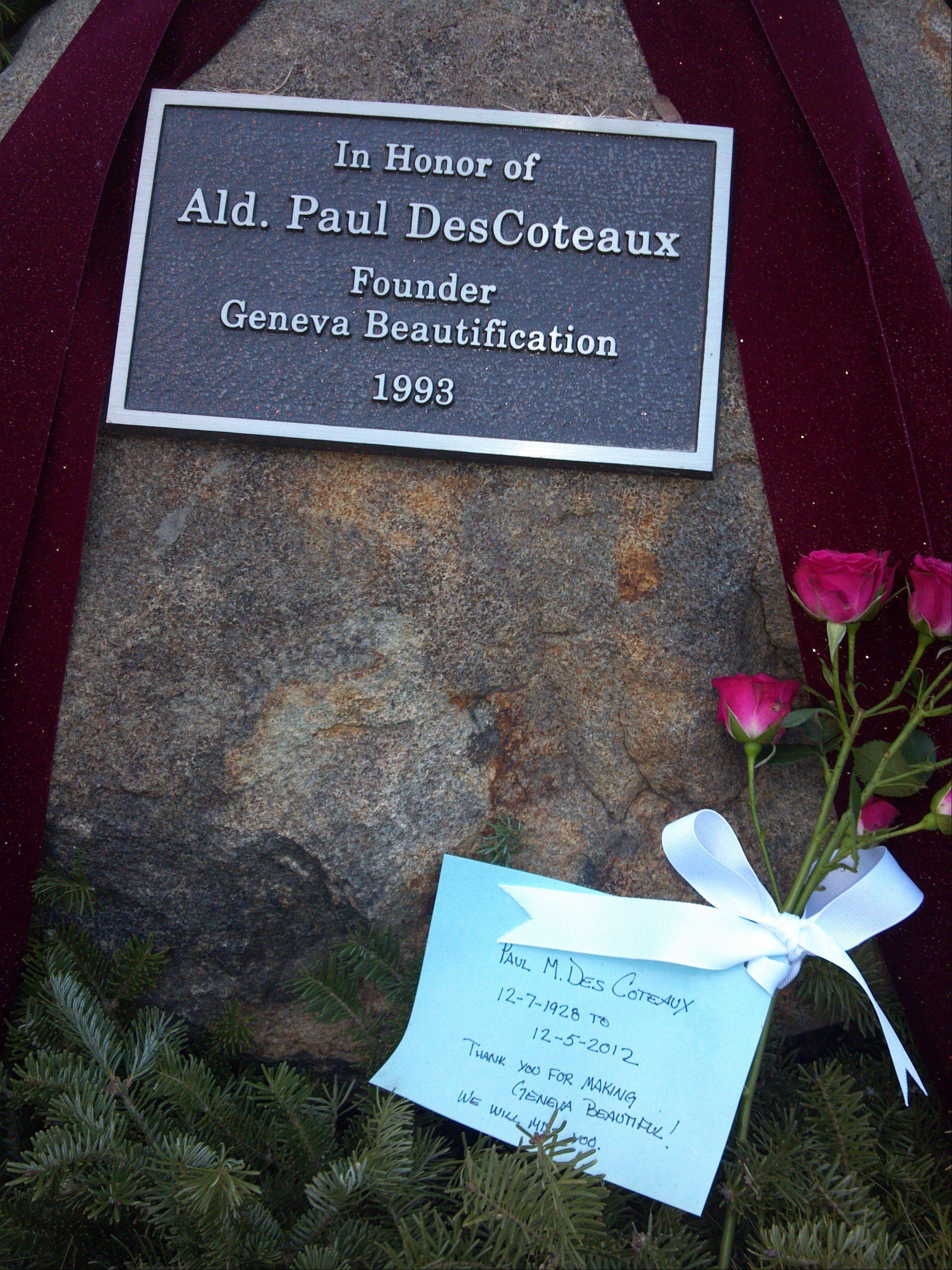 Someone placed a card and flowers on a rock outside the Geneva post office on Third Street for Paul DesCoteaux.