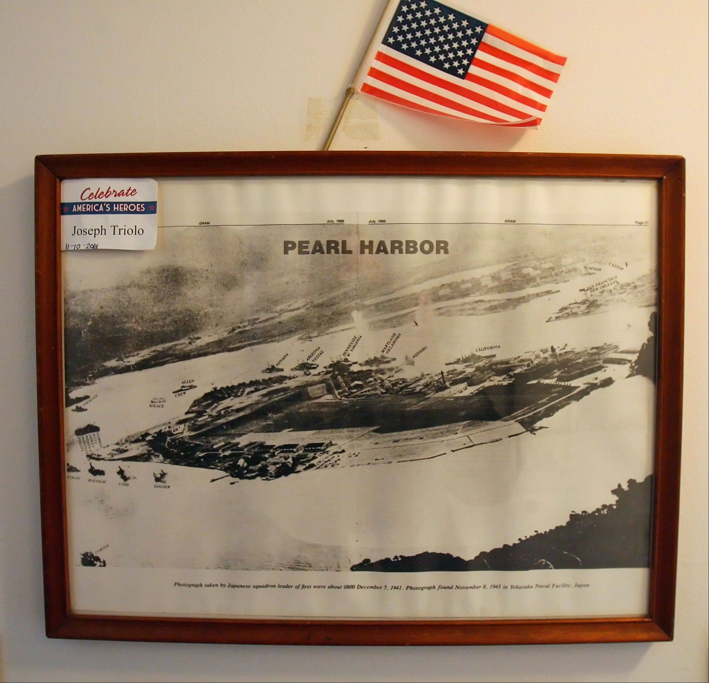 This replica photo of Pearl Harbor shot by a Japanese pilot hangs on the wall of 92-year-old Pearl Harbor survivor Joe Triolo of Waukegan.