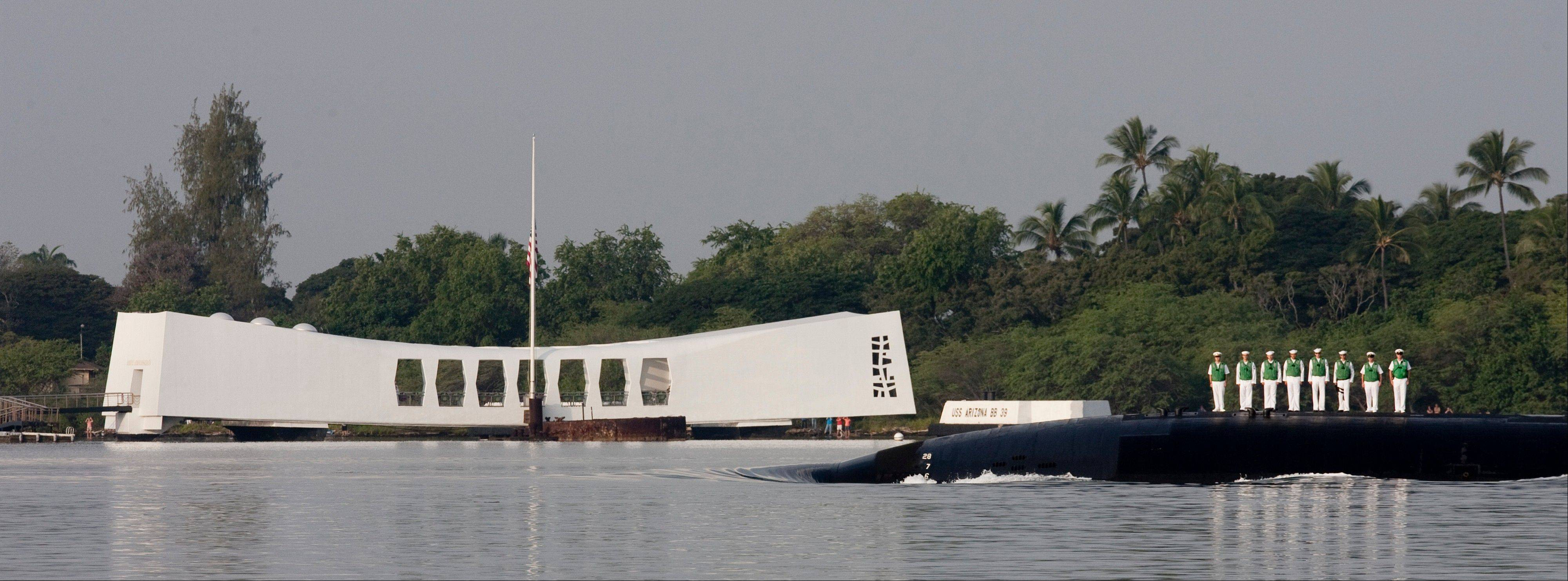 The bow of the submarine USS Tucson passes by the USS Arizona Memorial Friday, Dec. 7, 2012, at Pearl Harbor, Hawaii. Many of the Pearl Harbor Veterans gathered at the World War II Valor In The Pacific National Monument remembering the 71th anniversary of the Dec. 7, 1941 Japanese surprise attack on Pearl Harbor in Honolulu.