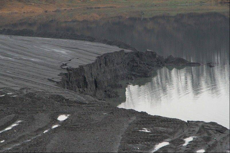 With a driver and his bulldozer missing in a thick, dark lake of coal slurry, a mine safety expert and critic of the coal industry says regulators are ignoring stricter construction standards that could prevent more failures at hundreds of similar dam-like structures around the country.