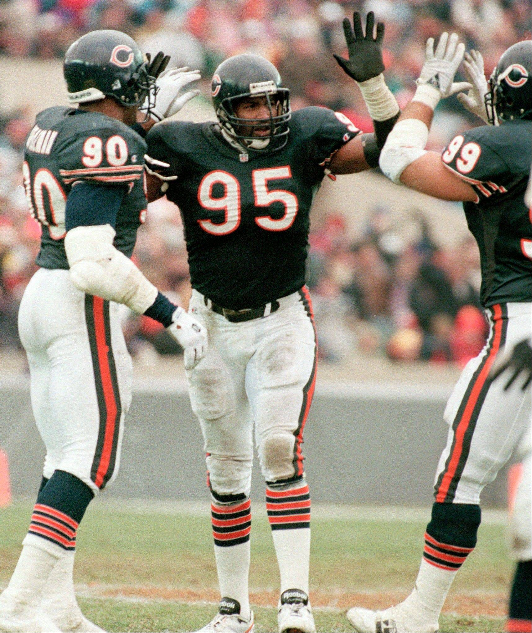 "Richard Dent, center, a member of the legendary 1985 Chicago Bears' defense, talks about his playing days, his teammates and changes in the game in his book ""Blood, Sweat and Bears."" He'll discuss the book and his career Dec. 8 in Naperville."