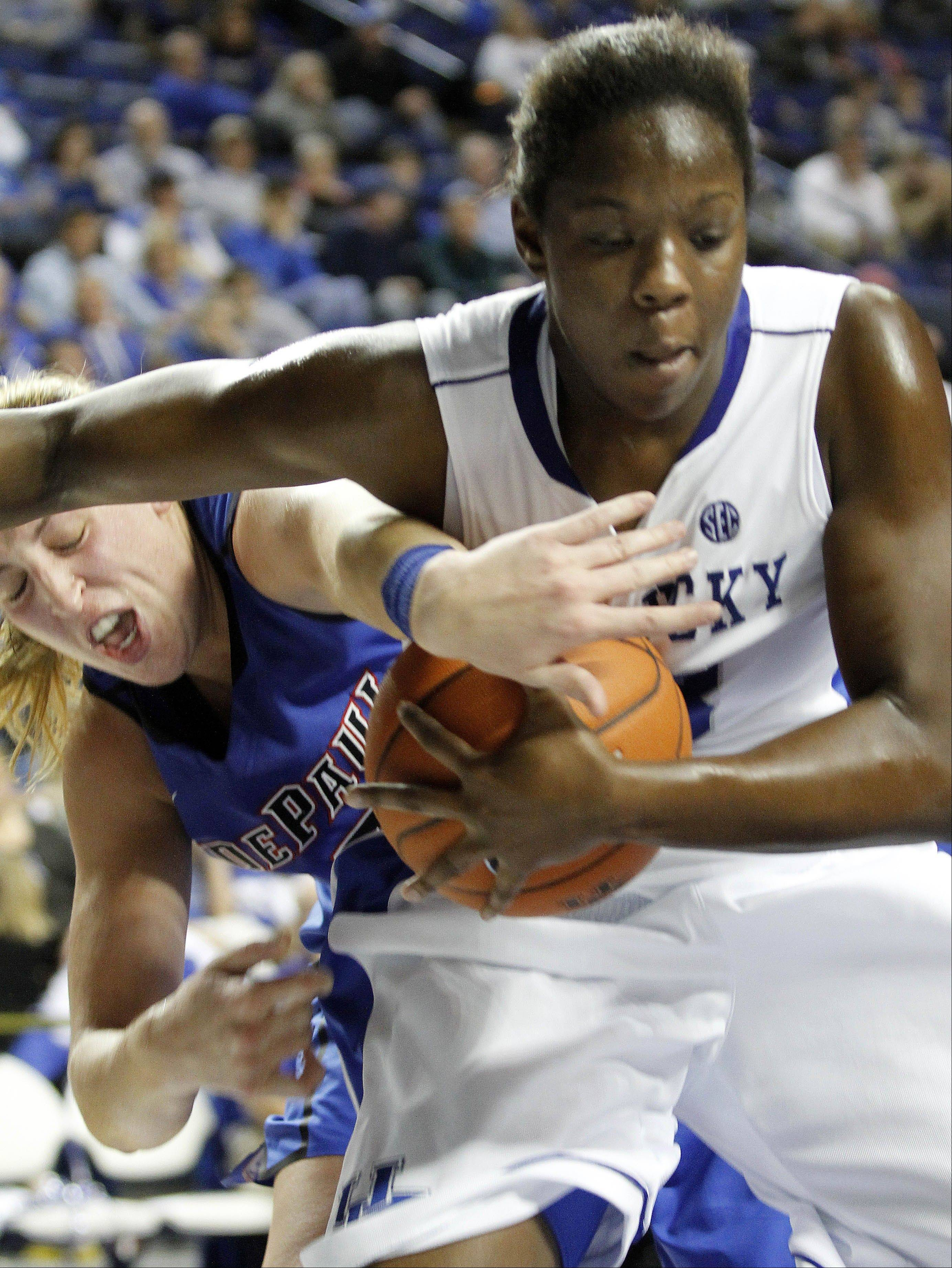 Kentucky's Samarie Walker, right, is pressured by DePaul's Katherine Harry, left, Friday during the second half at Rupp Arena in Lexington, Ky. Kentucky won 96-64.