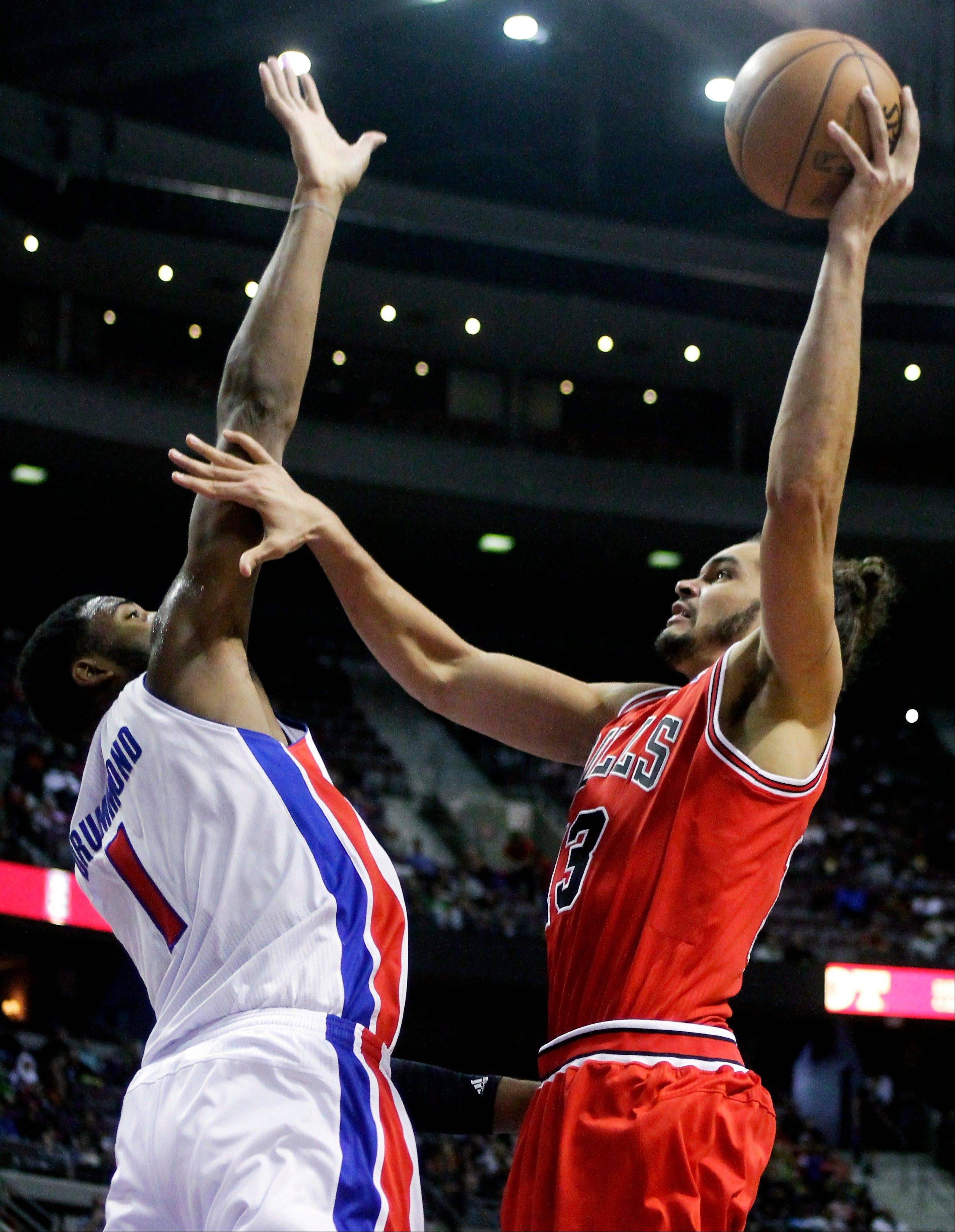 Bulls center Joakim Noah goes to the basket against Detroit Pistons forward Andre Drummond Friday during the first half of an in Auburn Hills, Mich.