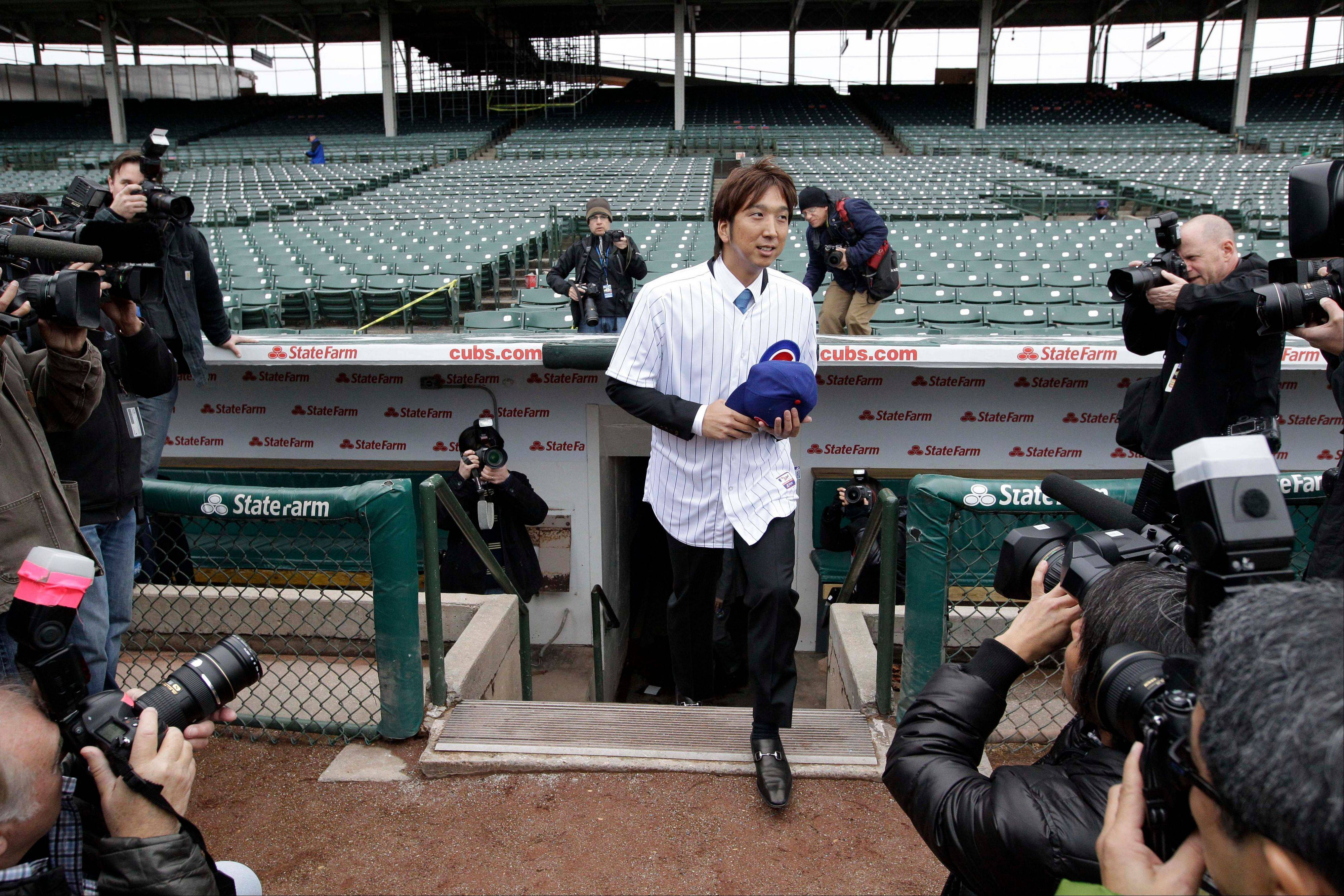 Cubs pitcher Kyuji Fujikawa steps take a look at Wrigley Field Friday after signing a $9.5 million contract with the Cubs.