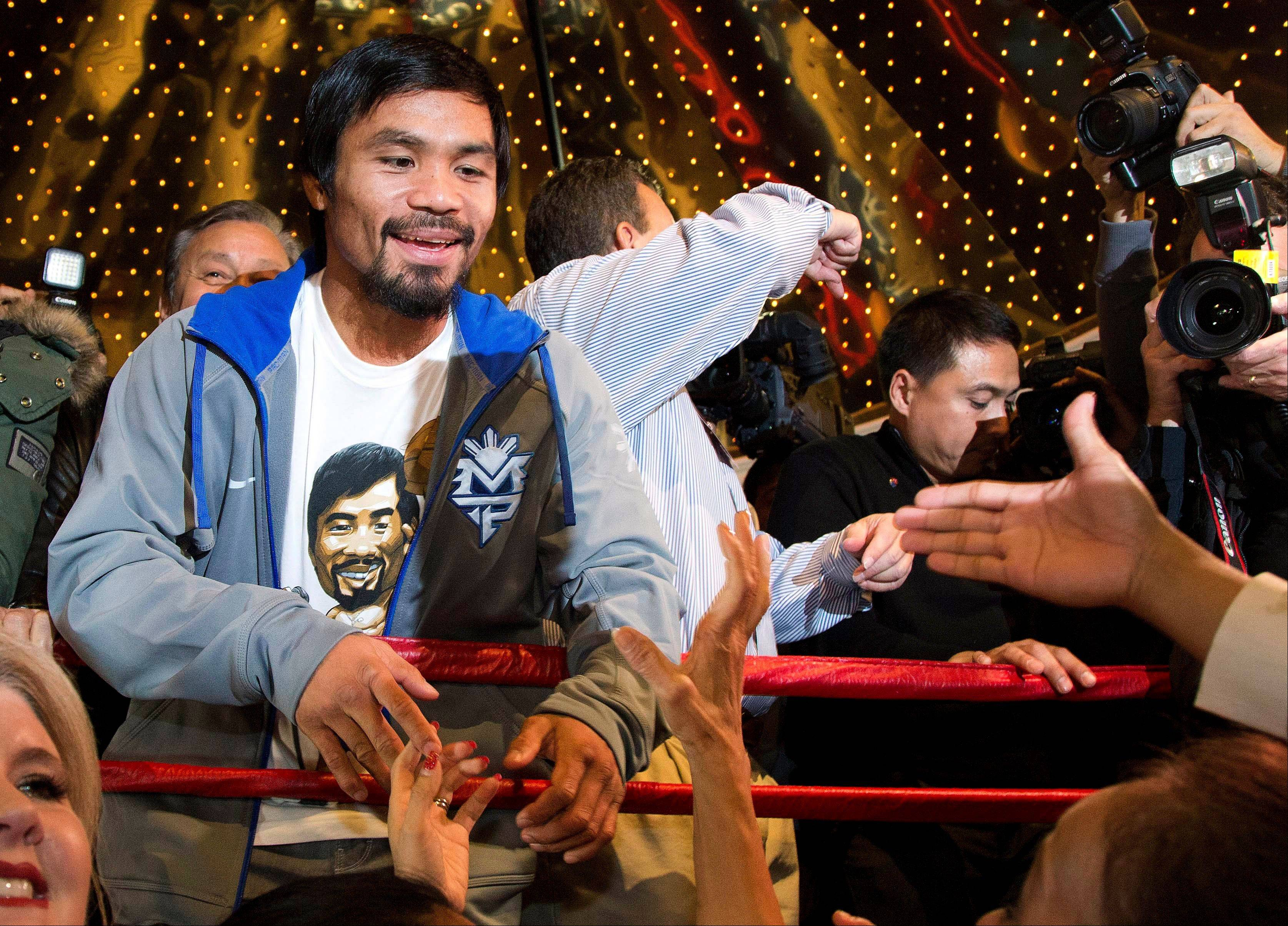 Manny Pacquiao greets fans Tuesday during his arrival at the MGM Grand Hotel-Casino in Las Vegas. Pacquiao is scheduled to face Juan Manuel Marquez in a welterweight rematch Saturday.