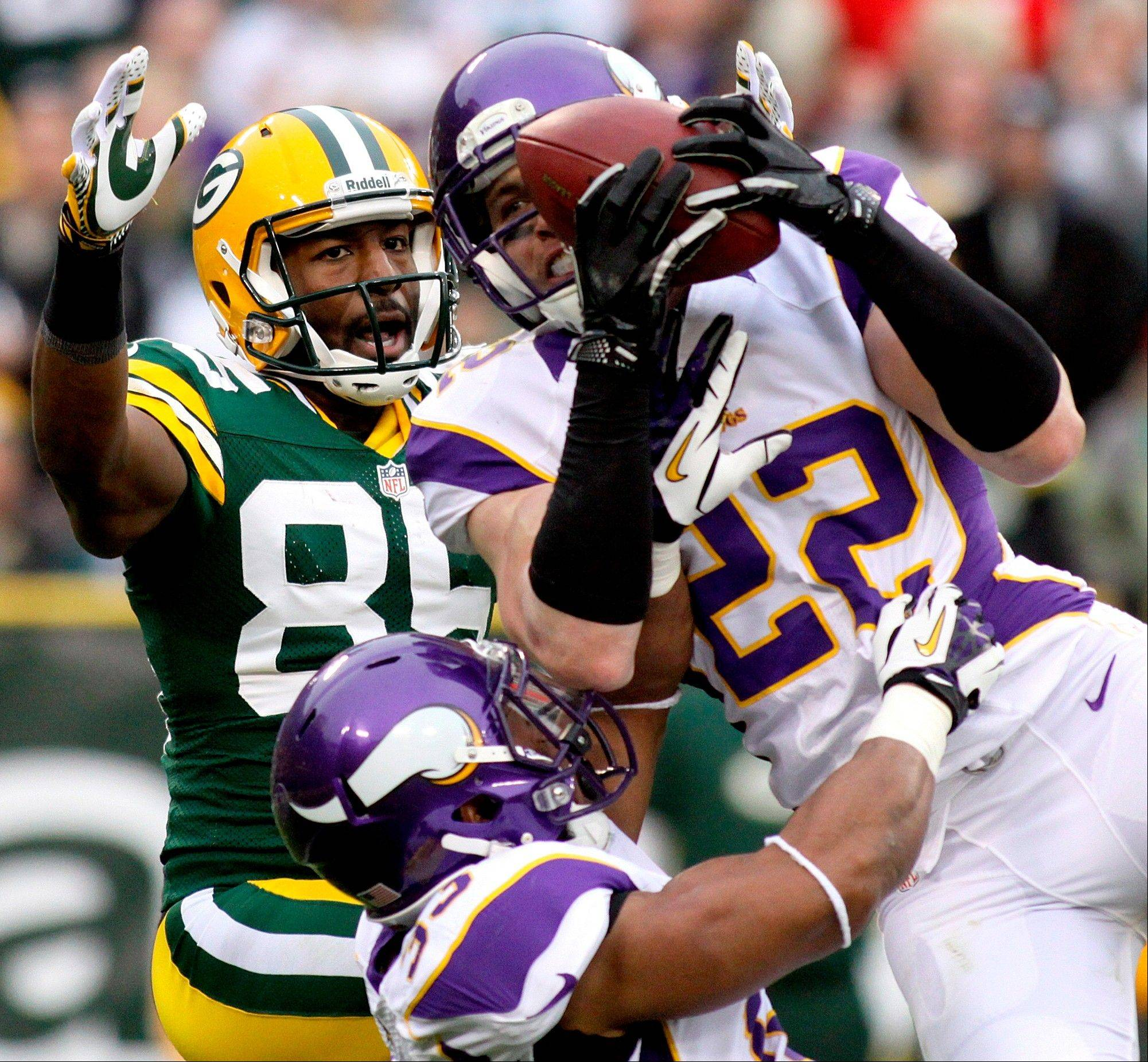 Minnesota Vikings safety Harrison Smith intercepts a pass intended for Green Bay Packers receiver Greg Jennings Sunday during the third quarter. Smith is one of five former Notre Dame players on the roster.