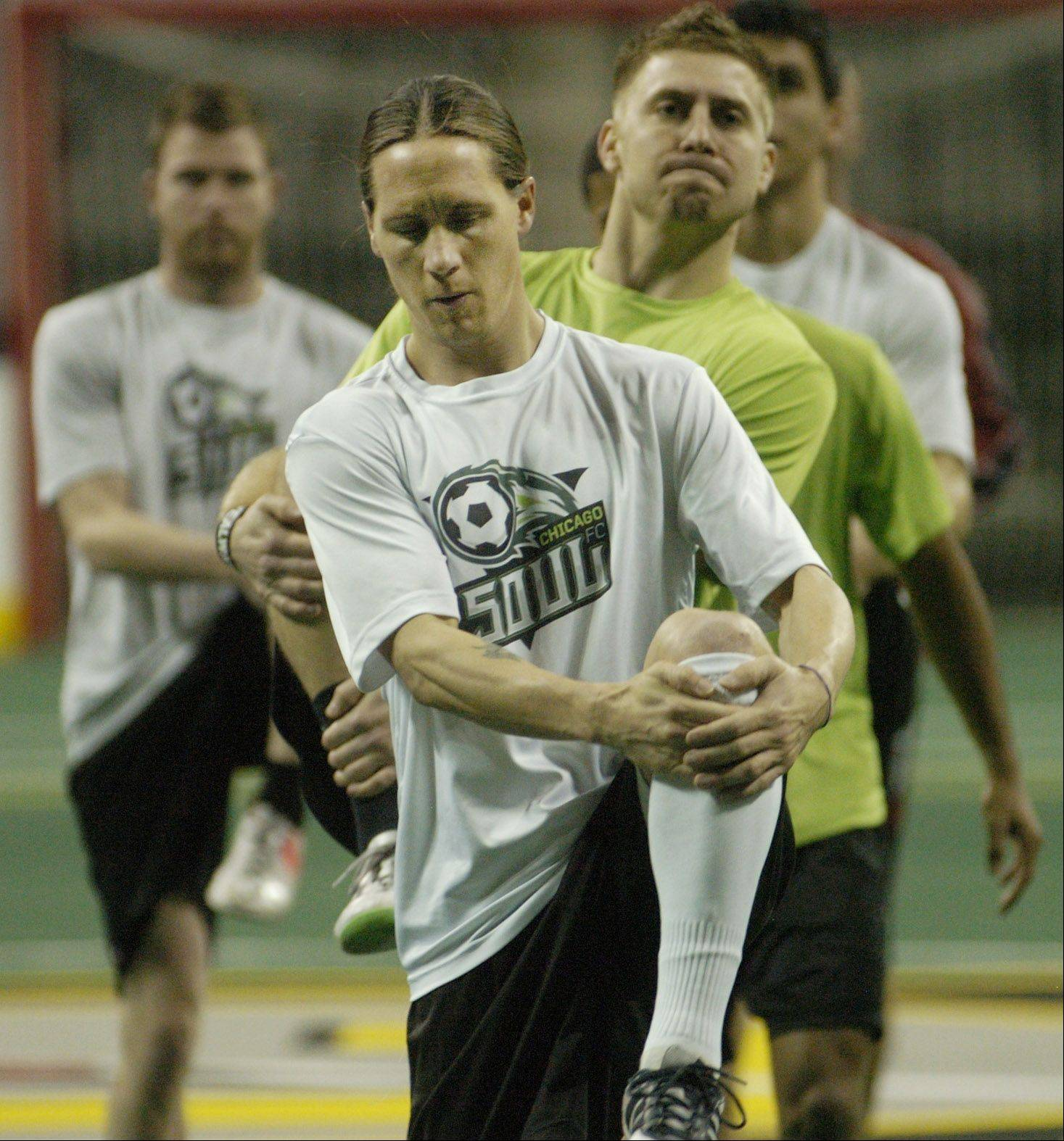 Team captain Matthew Stewart takes the team through warm-ups as the Chicago Soul indoor soccer team works out at the Sears Centre.