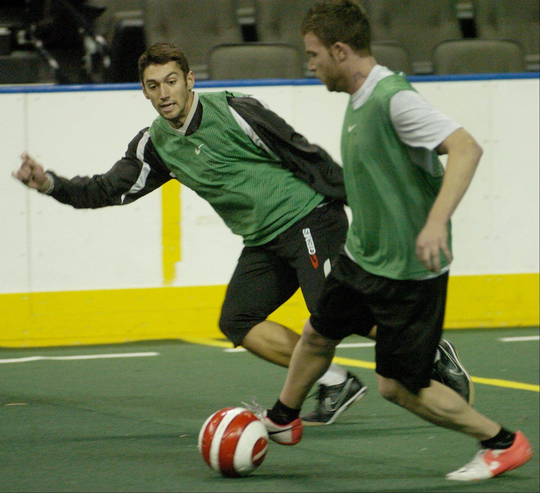 Aaron Nichols of Woodstock, left, works out with the Chicago Soul indoor soccer team at the Sears Centre.