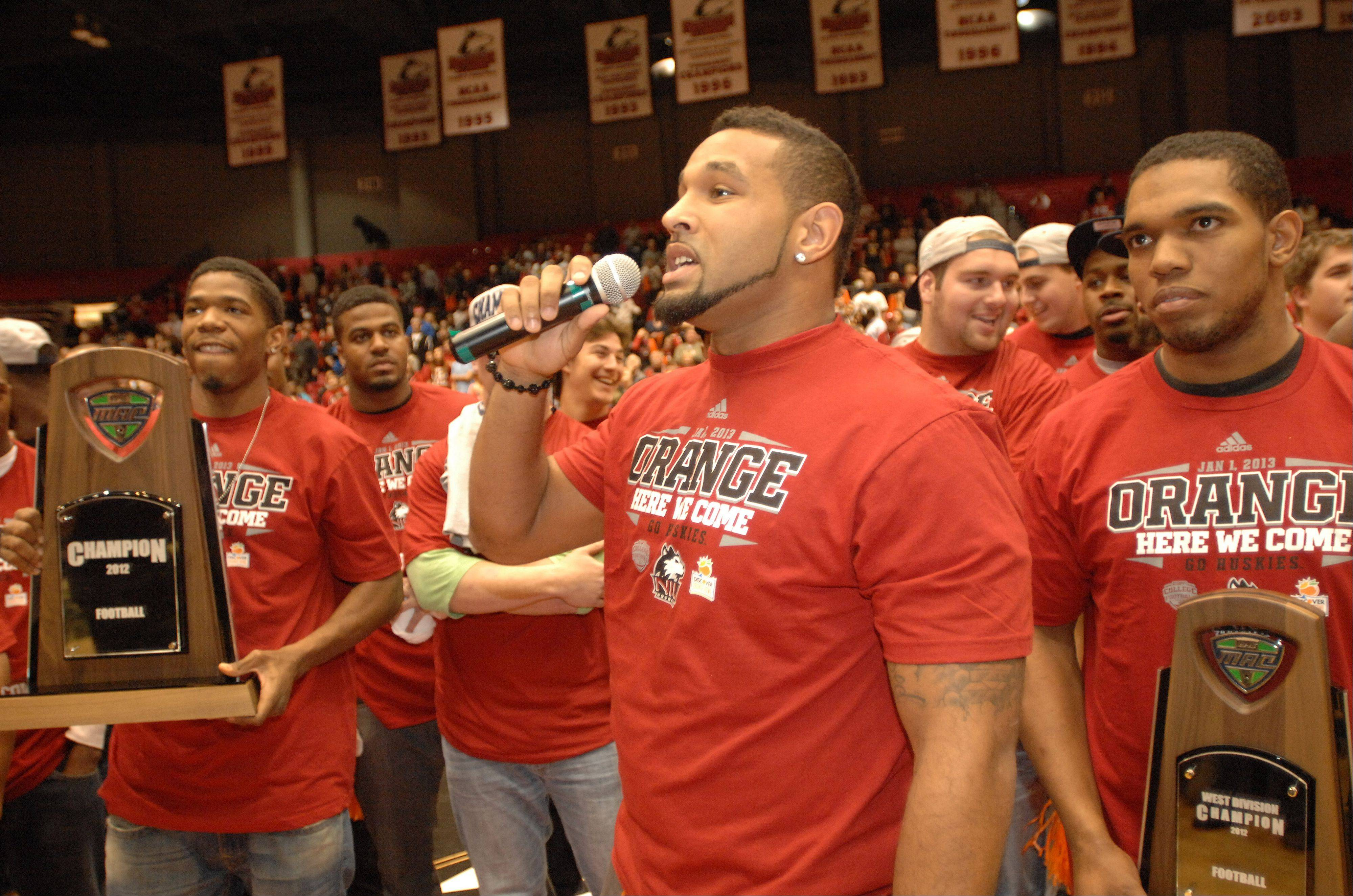 NIU defensive end Sean Progar pumps up the crowd during an Orange Bowl rally Wednesday on campus in DeKalb.