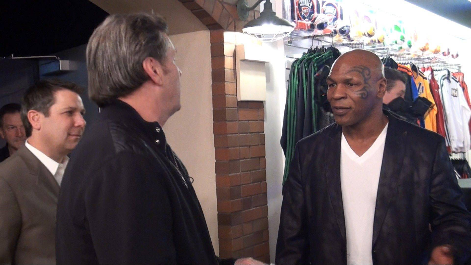 Submitted photoFormer boxing champ Mike Tyson talks with Mike North at the grand opening of the Score Interactive Sports Exhibit and broadcasting studio inside the Luxor hotel in Las Vegas.