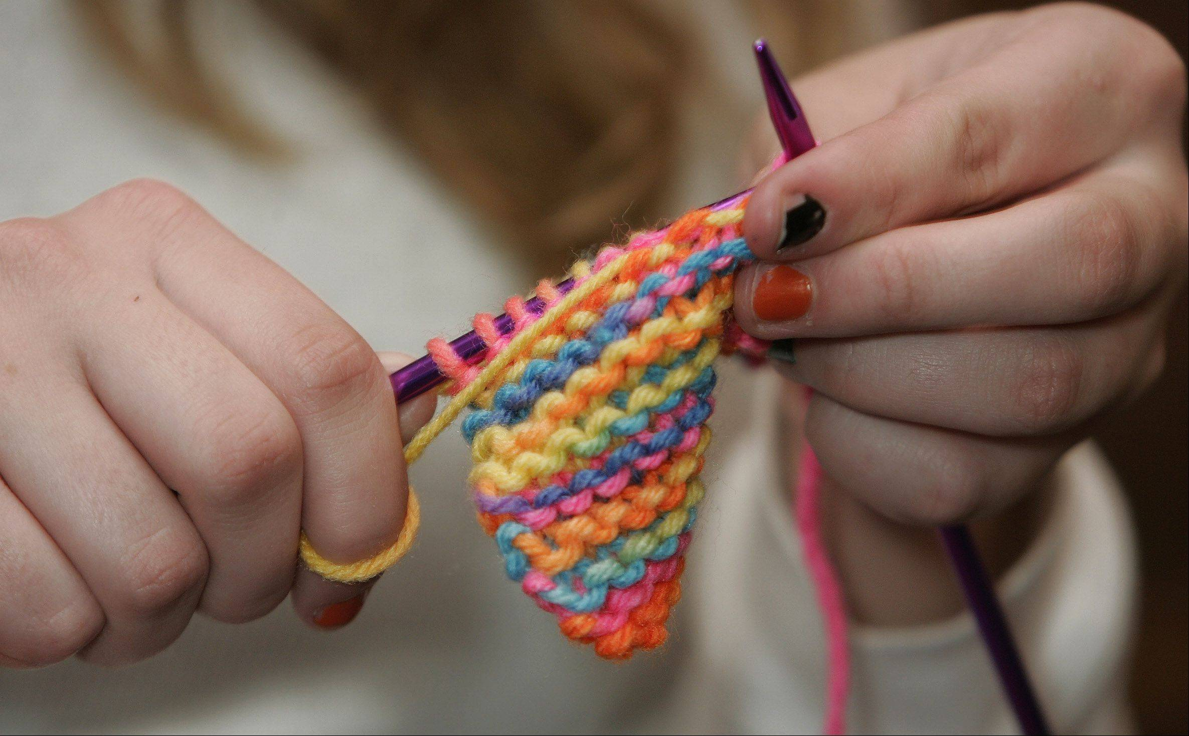 The Association for Individual Development is seeking volunteers to knit scarves to raise money for the organization.