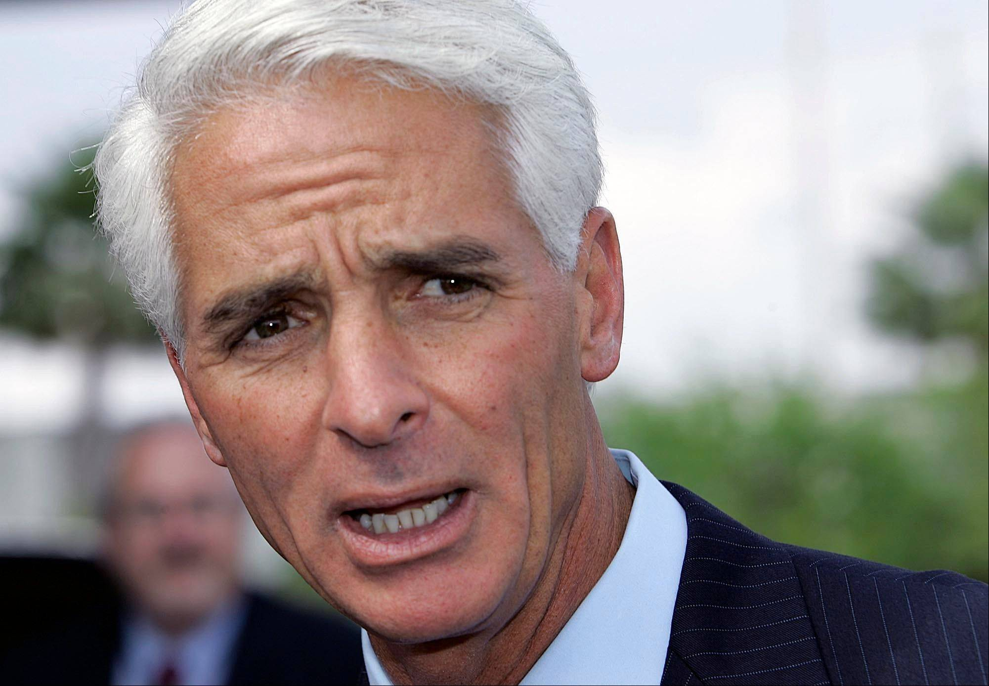 Florida Gov. Charlie Crist talks to the media at the Miami airport, about the plan to restore voting and other civil rights to felons who have finished their sentences.