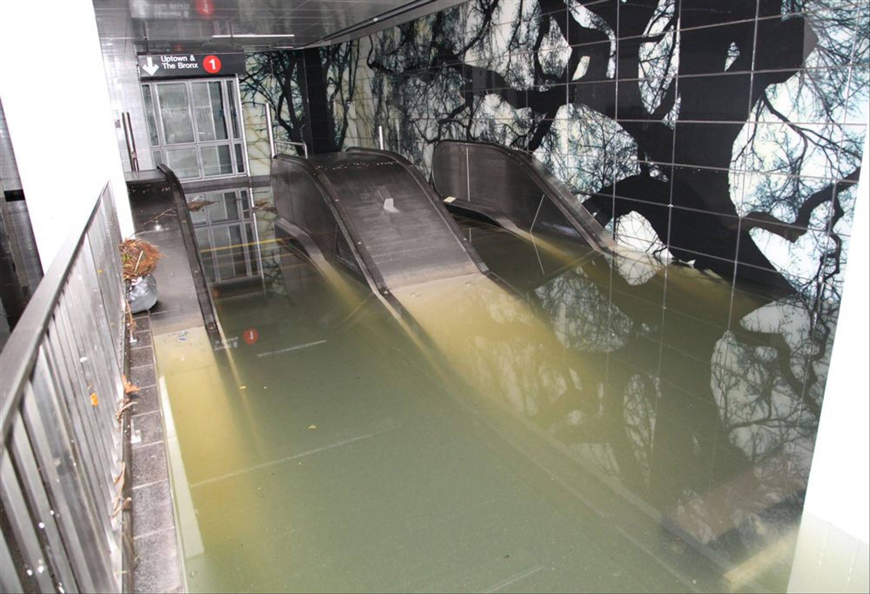 New York�s Metropolitan Transportation Authority, floodwaters rise above the top stair of an escalator in New York City�s South Ferry station in the wake of Superstorm Sandy.