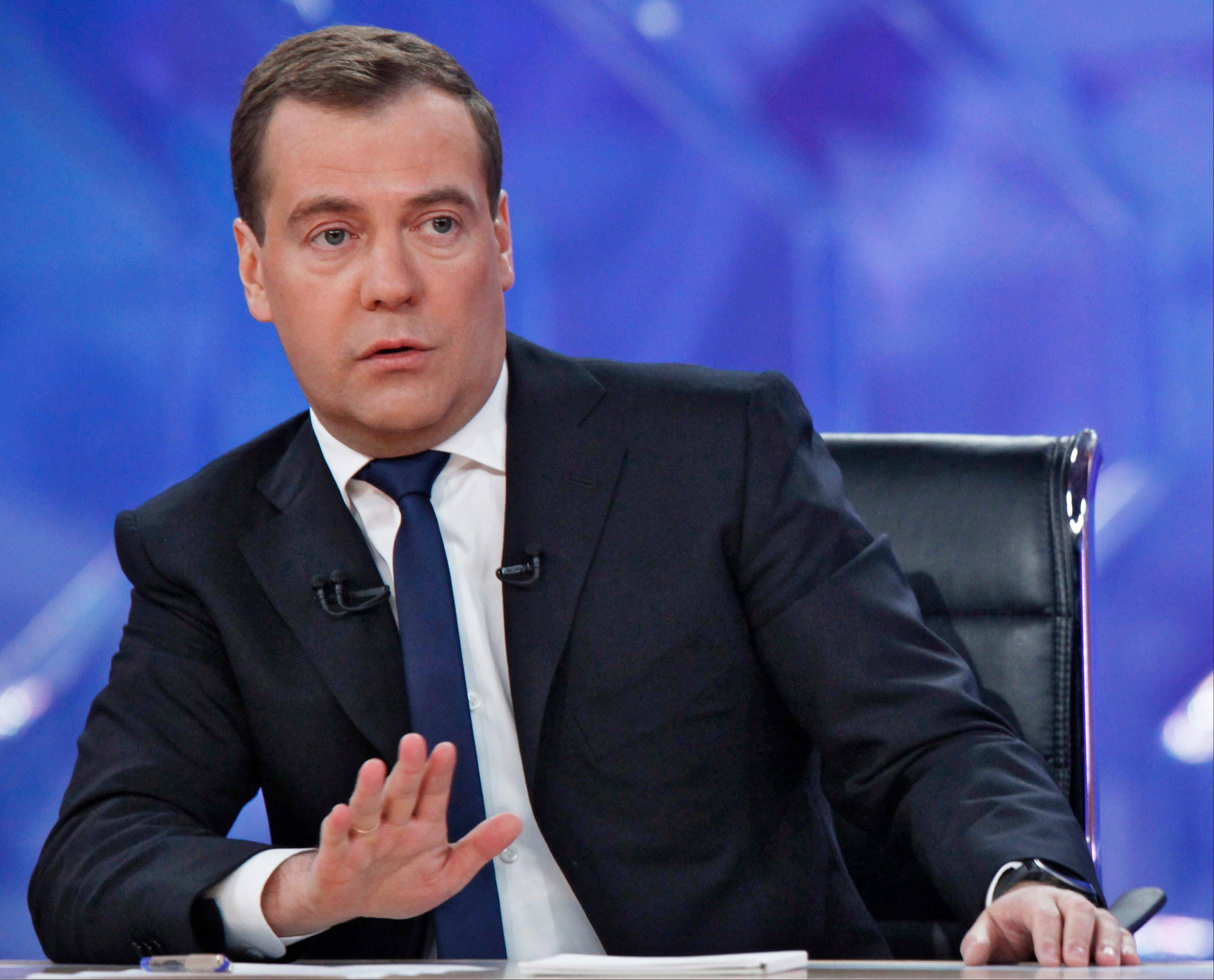 Russian Prime Minister Dmitry Medvedev speaks during live televised interview from Moscow�s Ostankino TV Center on Friday.