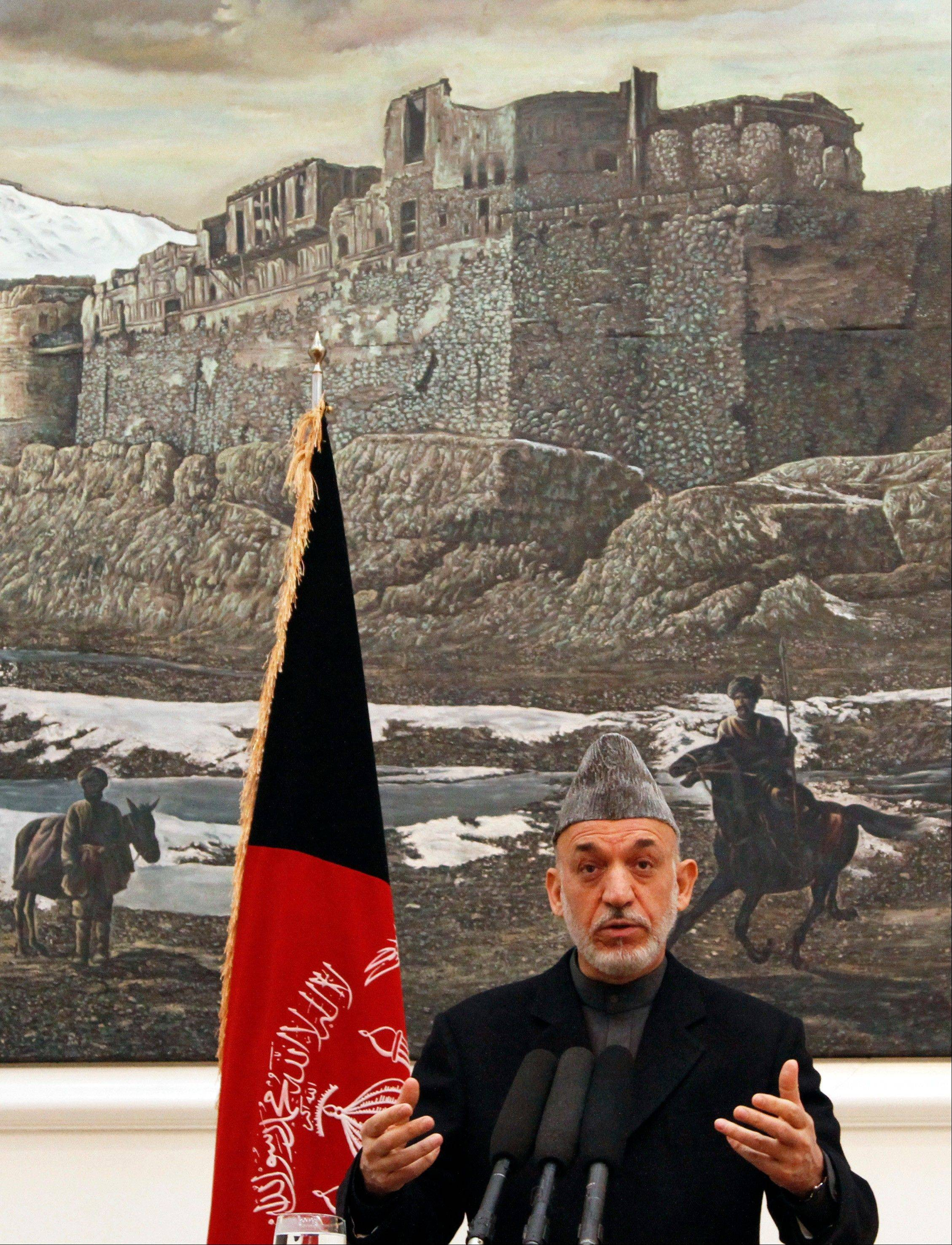 Afghan president Hamid Karzai gestures during a press conference Saturday at the presidential palace in Kabul Afghanistan.
