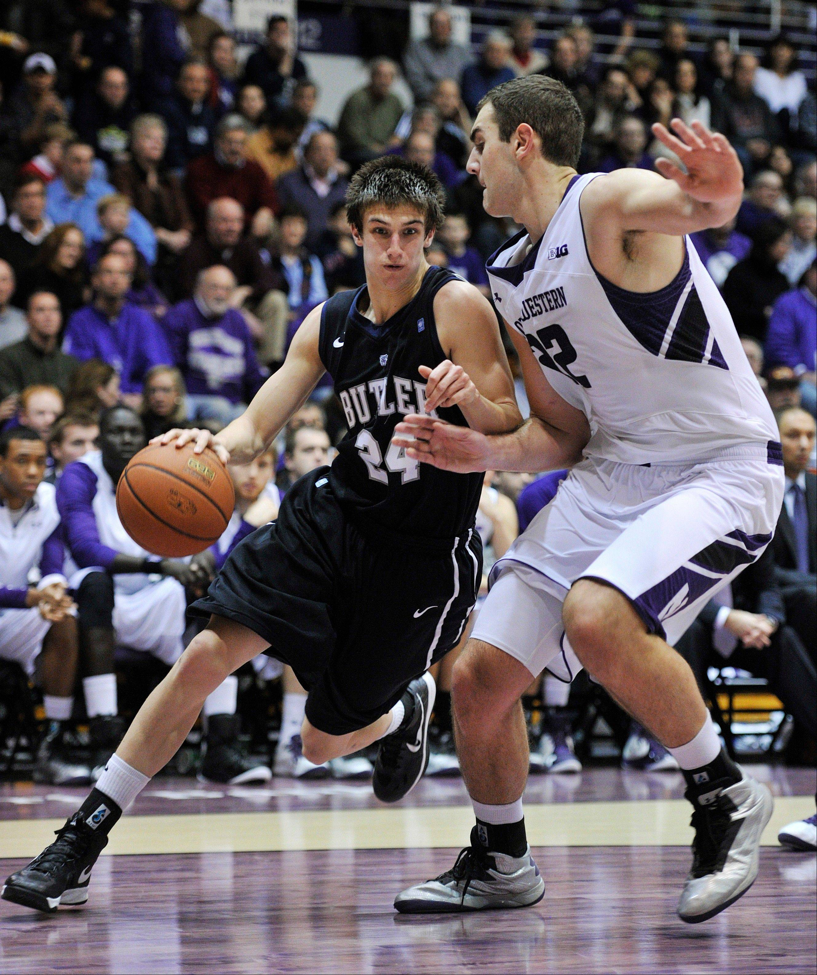 Butler�s Kellen Dunham (24) drives to the basket around Northwestern�s Alex Olah during the first half Saturday in Evanston.