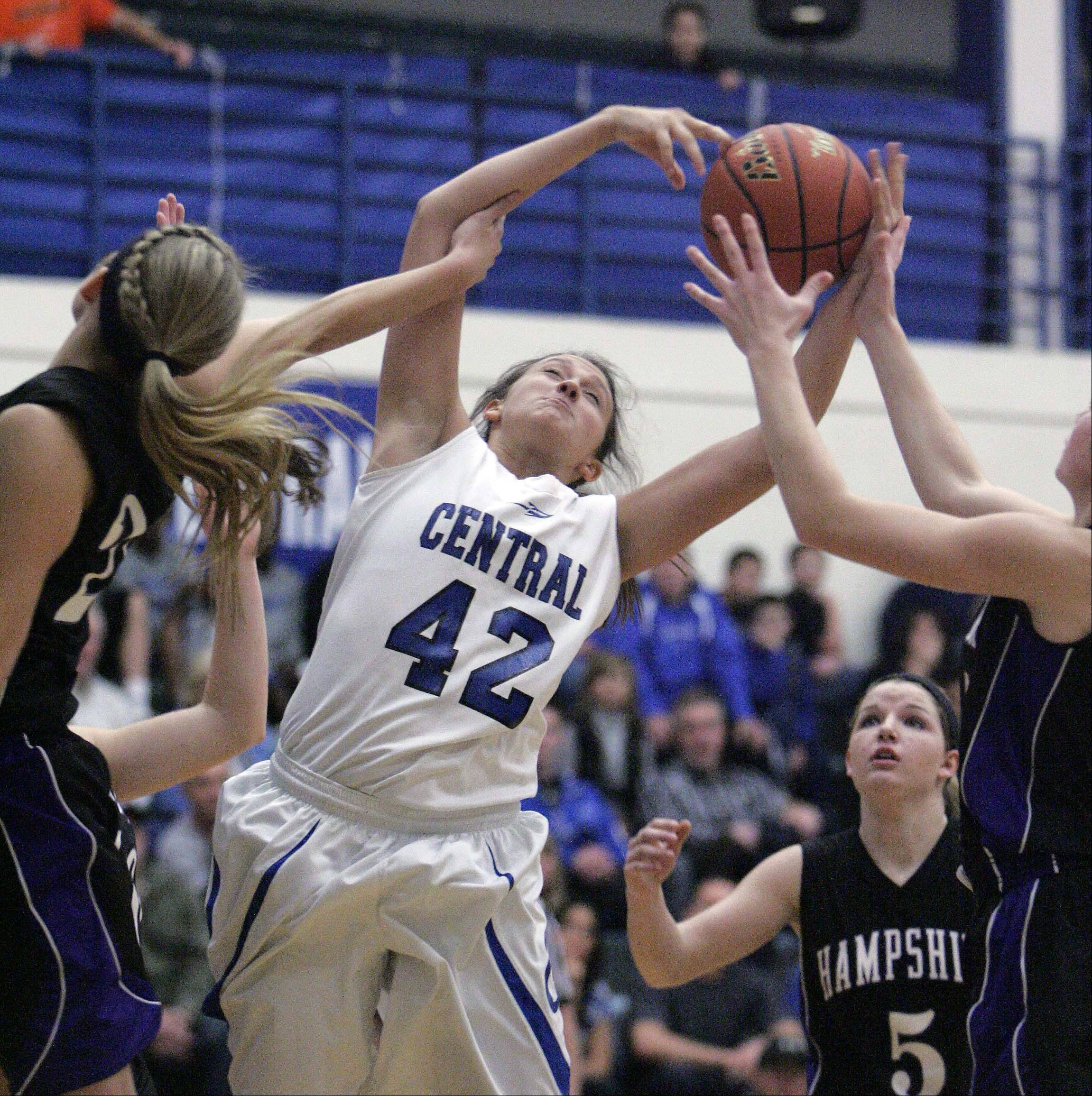 Burlington Central�s Alison Colby (42) rips down a rebound during the Rockets� 48-37 win over Hampshire at Burlington Central Saturday.