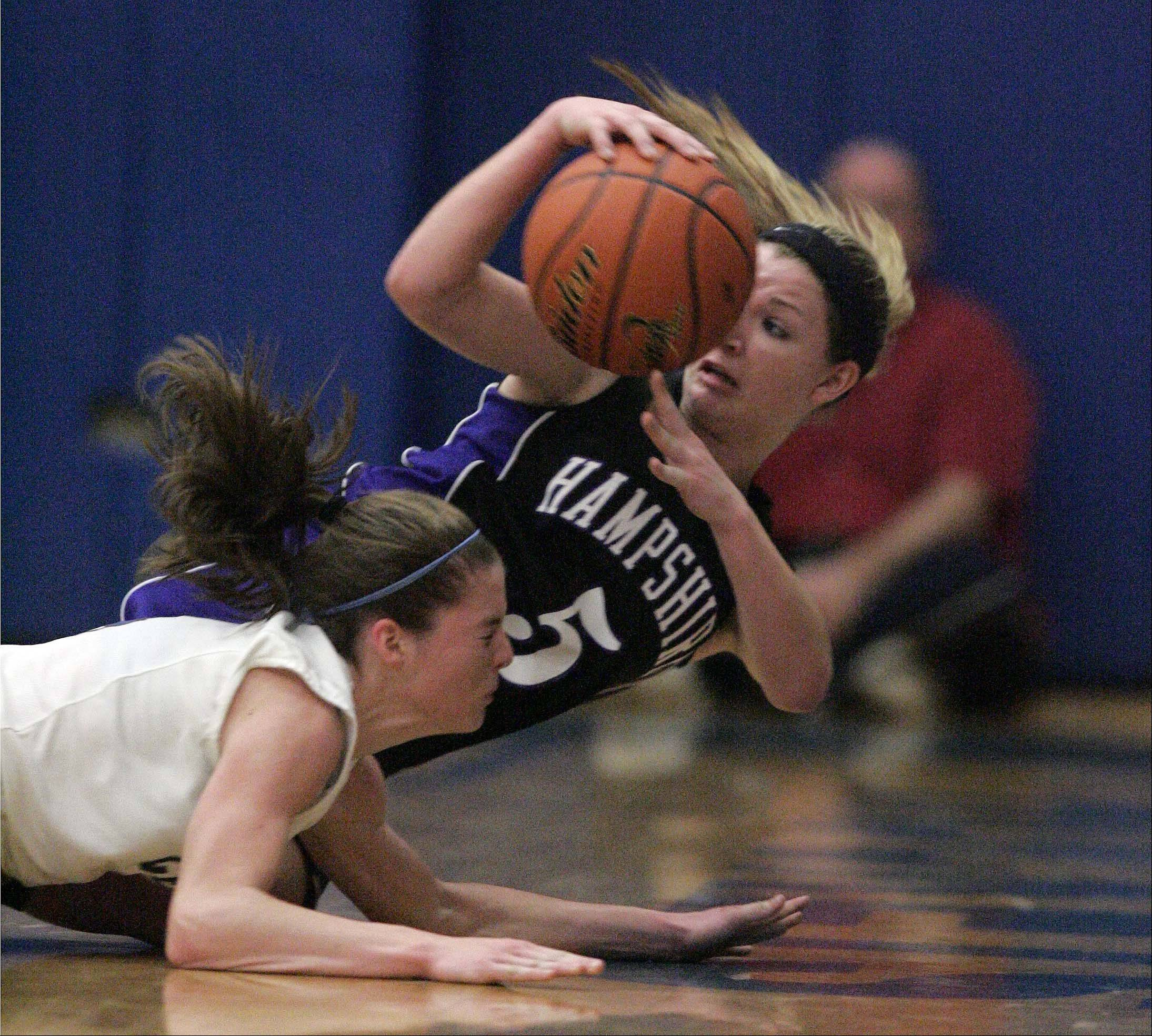 Hampshire guard Sara Finn (5) dives for a loose ball as Burlington Central�s Kayla Ross (4) tries to gain control also during Hampshire at Burlington Central girls basketball Saturday December 8, 2012.