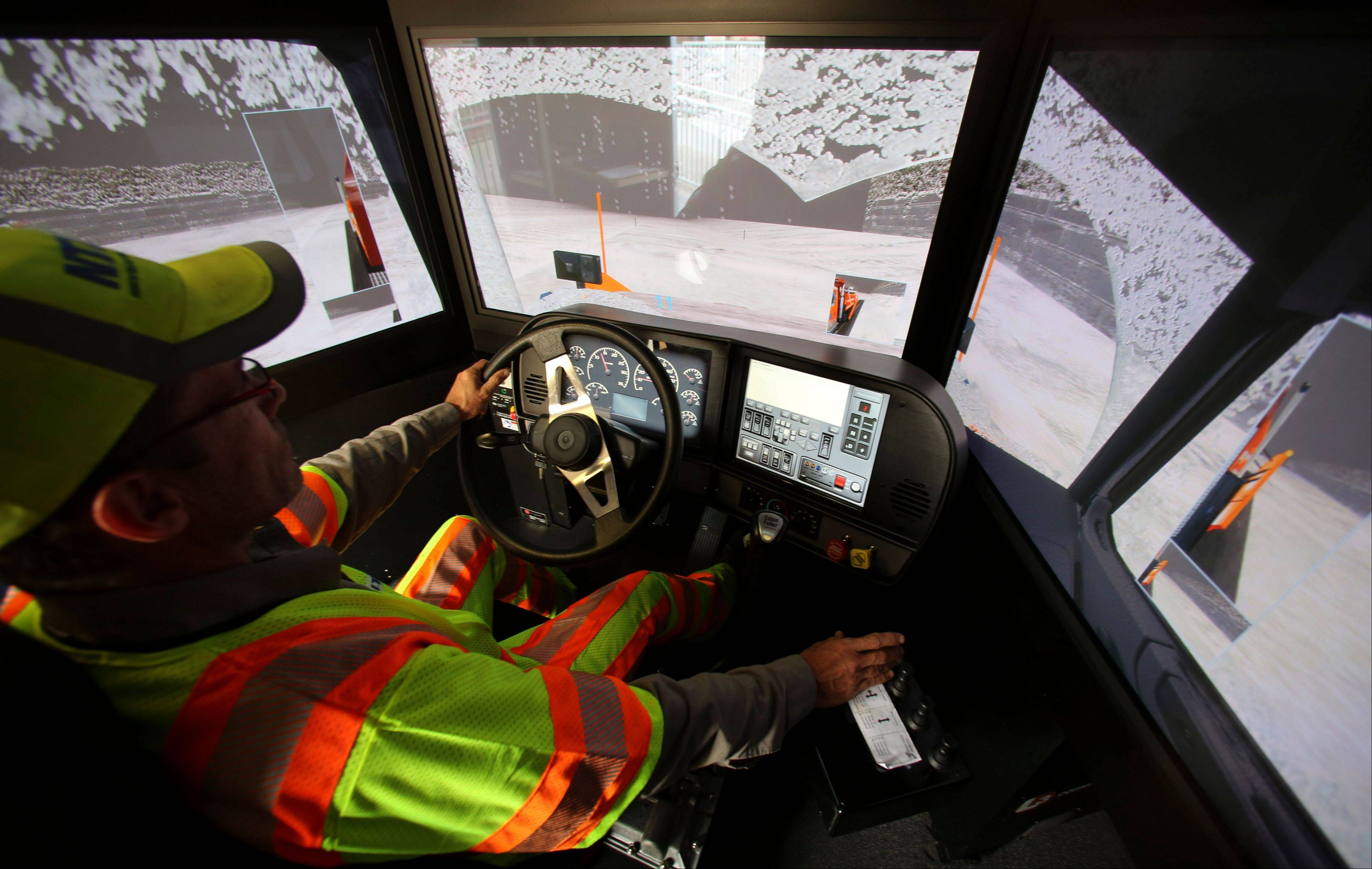 Driver Terence Mundt operates a snowplow simulator during a North Texas Tollway Authority training class in Plano, Texas. The NTTA is using the computer generated simulator to help snowplow operators become better at handling slick roads in a region not used to ice and snow. Highway officials in at least nine states are using the sophisticated simulator to give plow drivers a chance to practice snow removal in any weather. It works like a video game, recreating slick pavement, poor visibility and even children or animals bolting across the road.