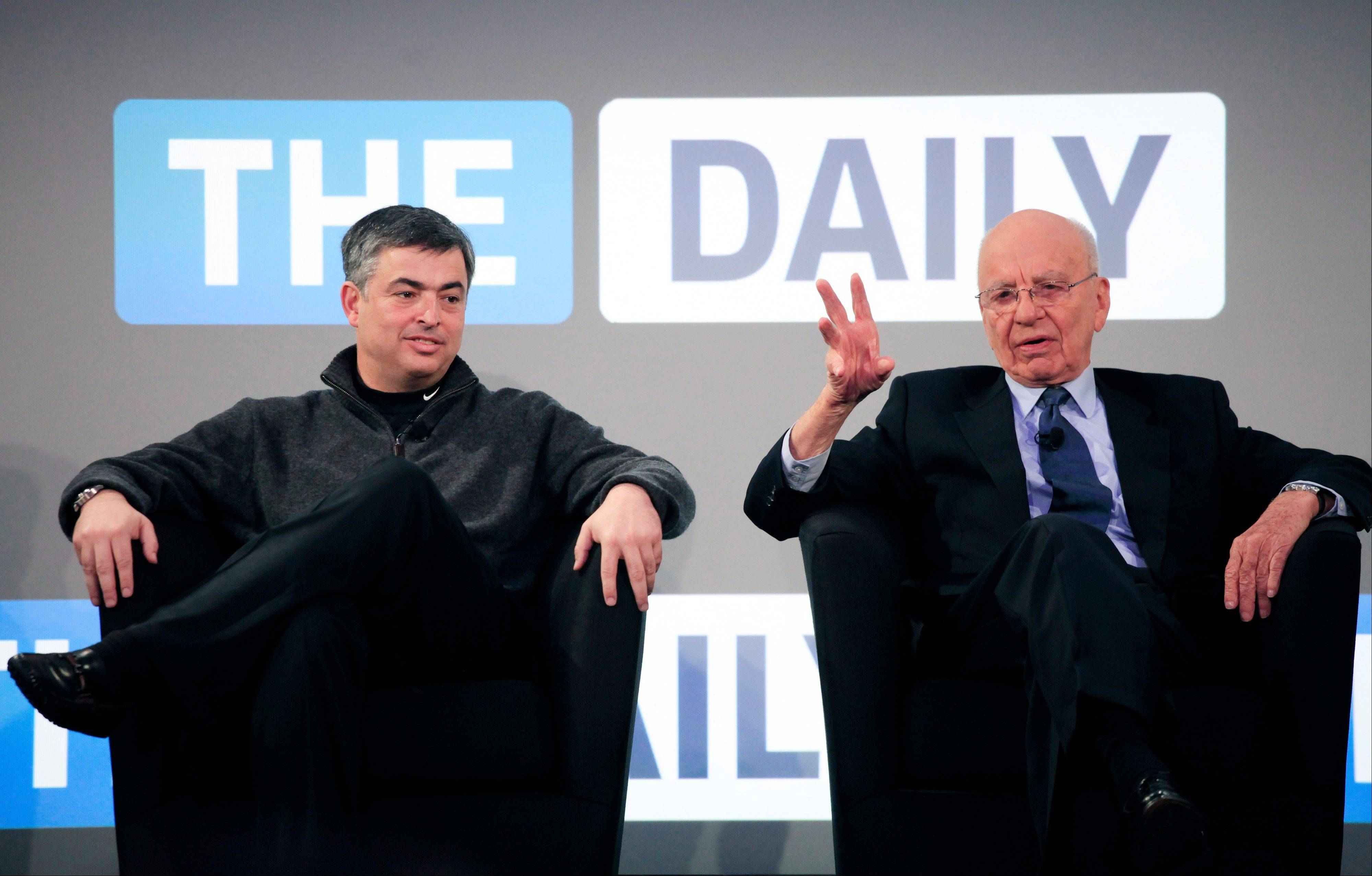 Rupert Murdoch, right, Chairman and CEO of News Corporation, and Eddy Cue, vice president of Apple, attend the launch of The Daily. News Corp. said it will cease publication of The Daily on Dec. 15. News Corp. had hoped The Daily would lure both paying subscribers and advertisers to a digital newspaper that included news, gossip and opinion.