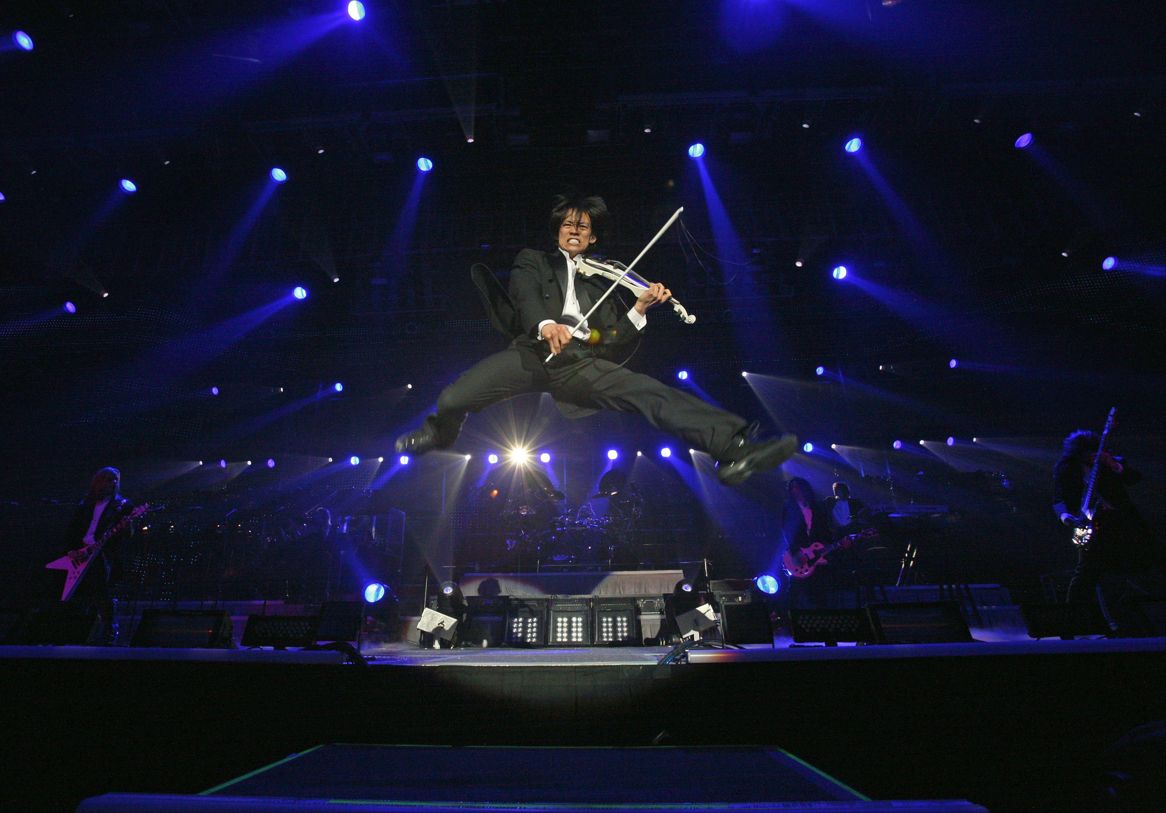 Roddy Chong, of Schaumburg, leaps into the air while playing rock violin with the Trans-Siberian Orchestra, which performs two shows Saturday, Dec. 8, at the Allstate Arena.