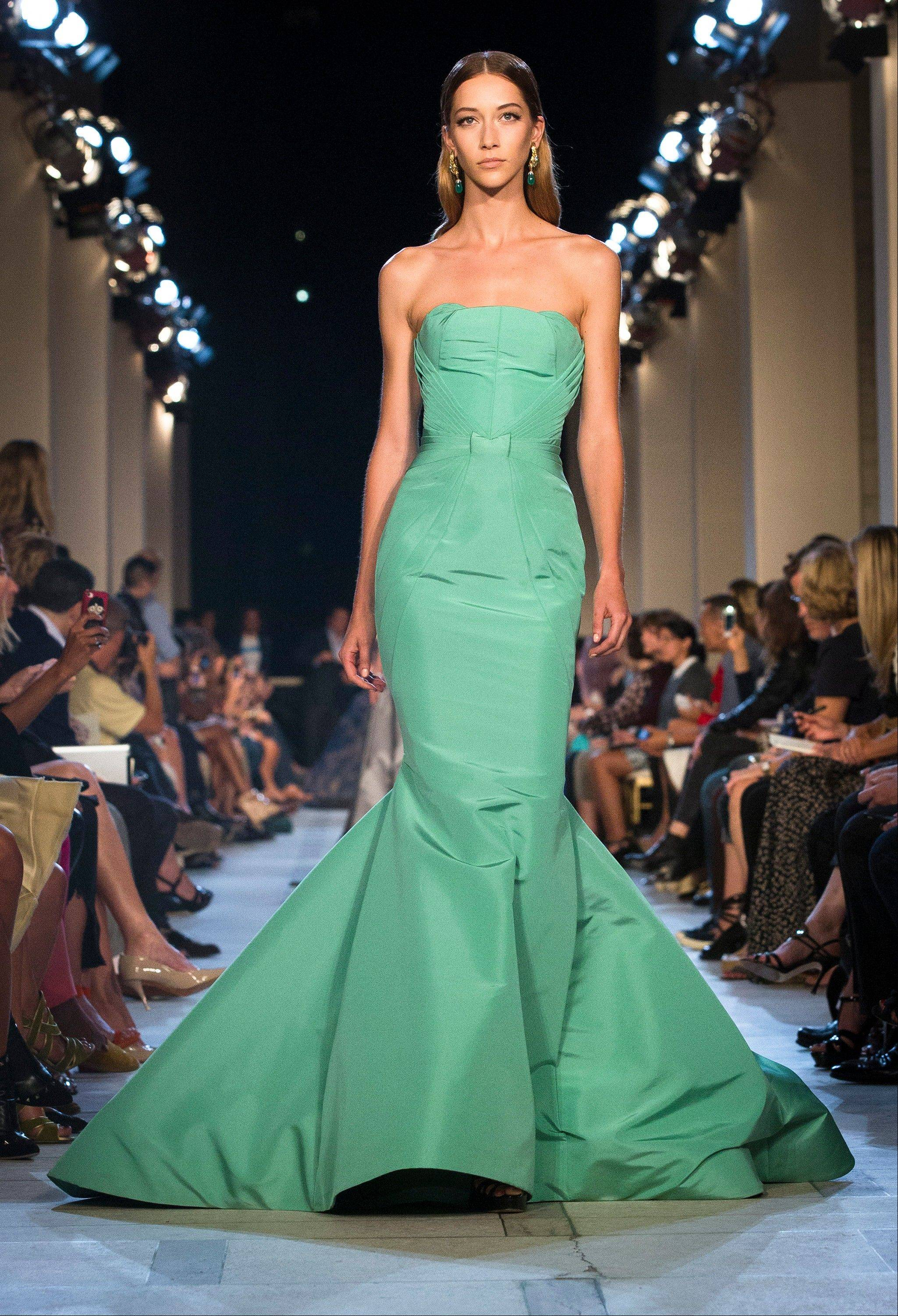 A dress from the Zac Posen spring 2013 collection features the rich, vibrant shade of emerald green.