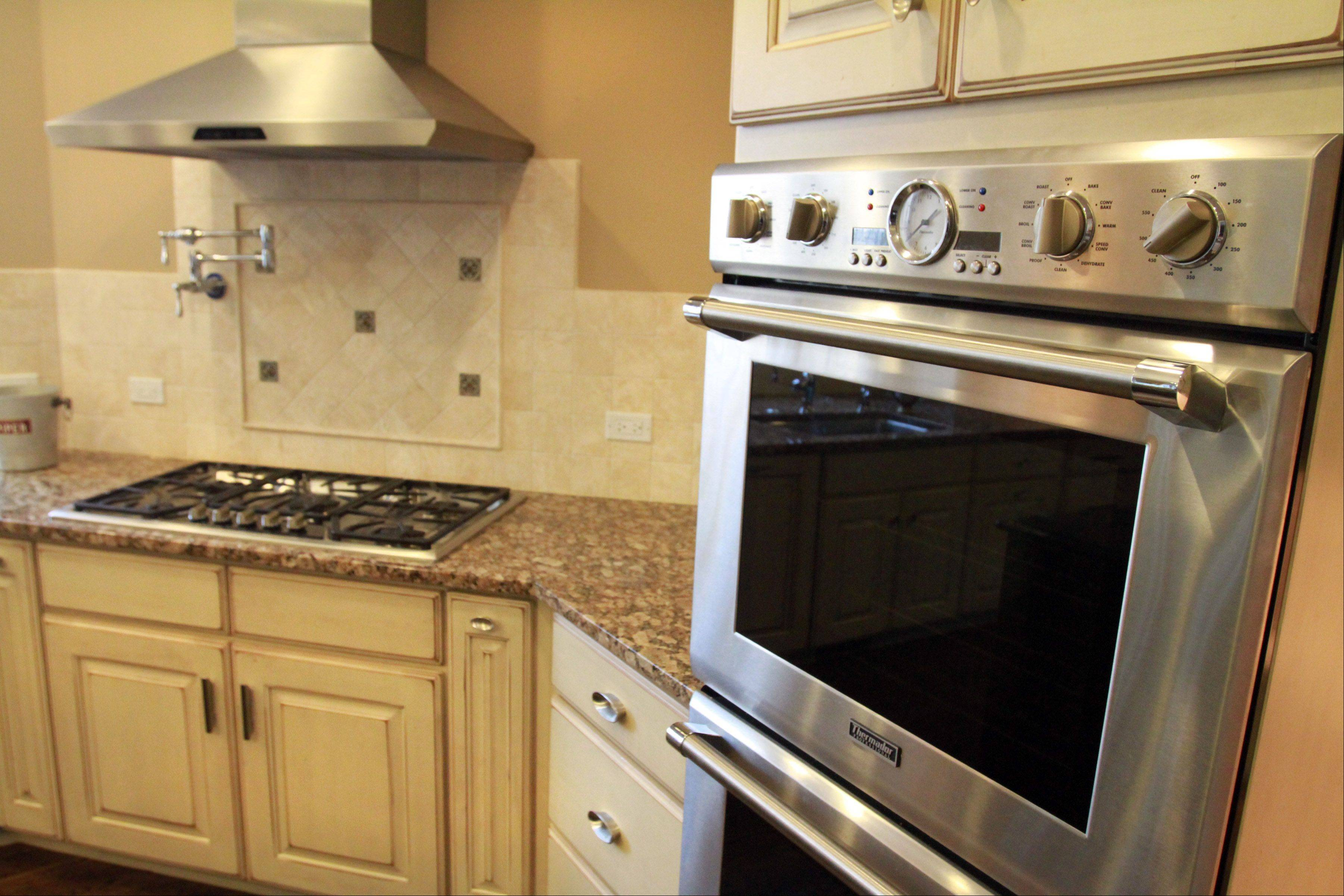 A double oven helps the Fretzin family keep a kosher kitchen, designed by architect David Wytmar, partner in Groundwork Ltd. of Buffalo Grove.