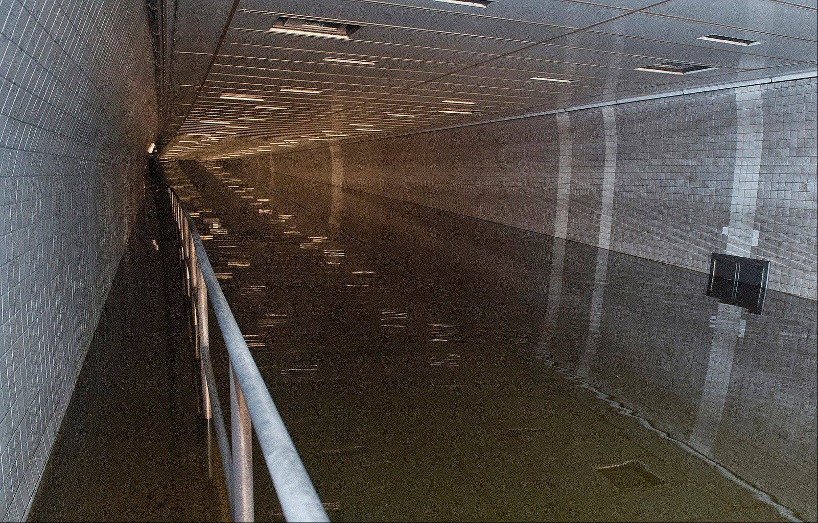 Water floods the Hugh L. Carey Tunnel, formerly known as the Brooklyn Battery Tunnel, during Superstorm Sandy, in New York.
