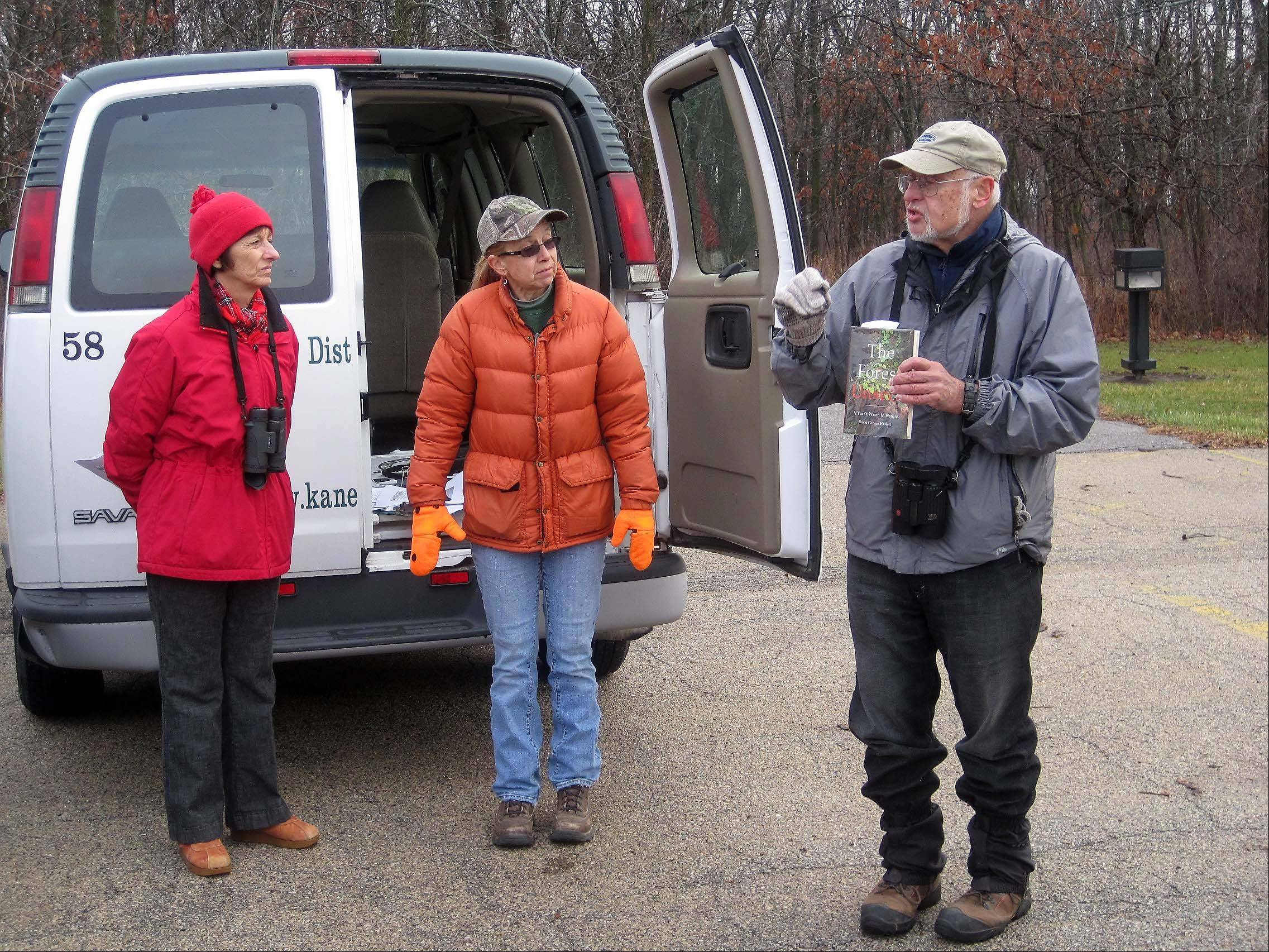 "Elena Ferrarin/eferrarin@dailyherald.comNaturalist and birdwatching expert Jack Pomatto, right, lead the ""Woodpeckers in Winter� nature program Saturday morning at Fermilab in Batavia. Also pictured are Valerie Blaine, nature programs manager for the Kane County Forest Preserve District, middle, and Nancy Kopman of Batavia, left, who was among 19 participants."