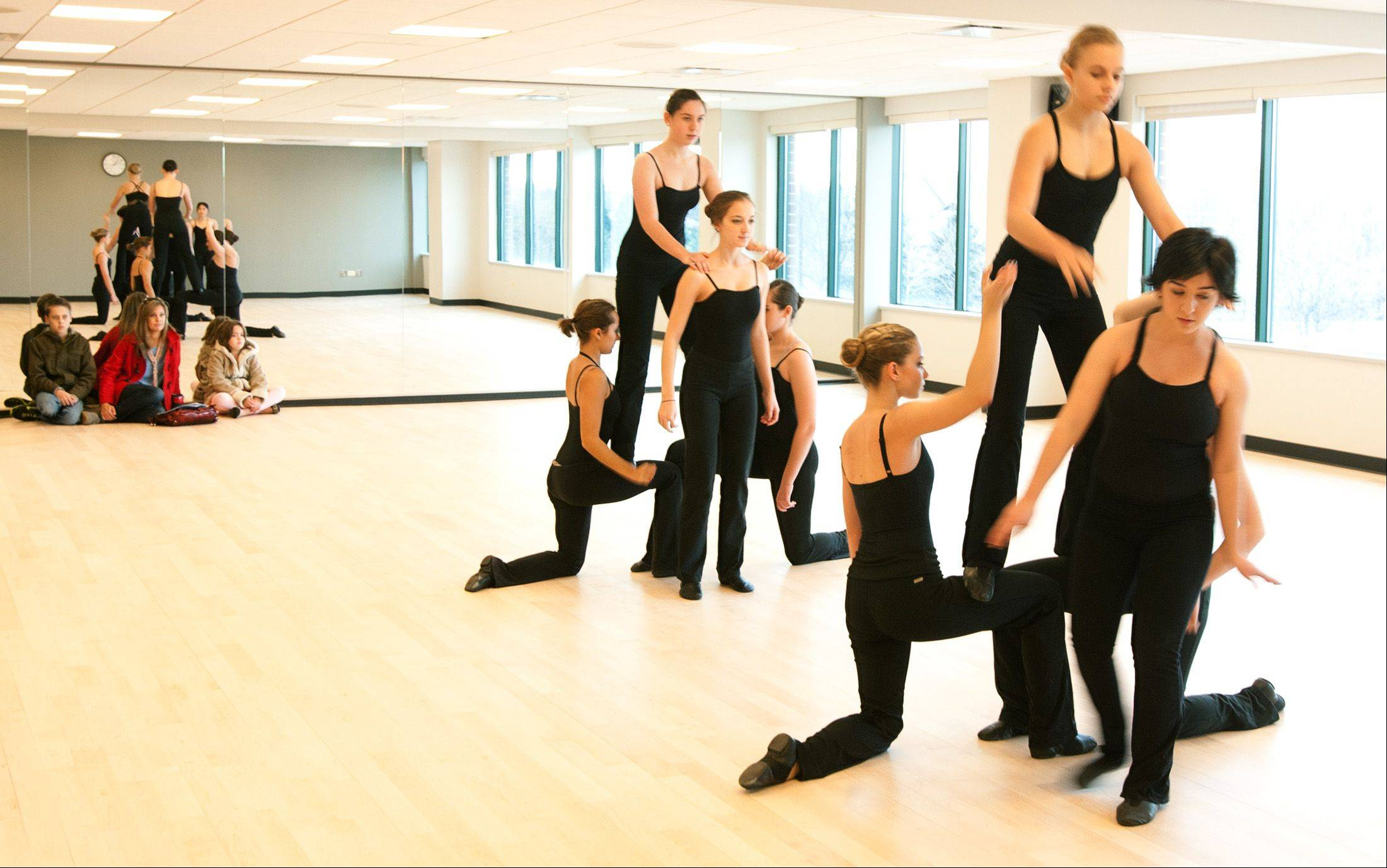 The �lan Dance Company performs in a wood-floored studio Saturday during the Naperville Park District's grand opening of the new 95th Street Center.