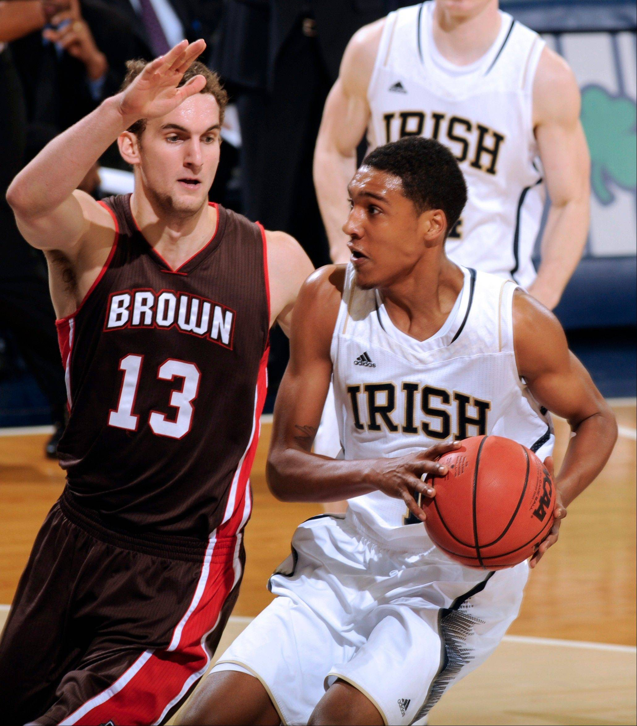 Notre Dame guard Cameron Beidscheid, right, drives the lane as Brown guard Tyler Ponticelli, defends during the second half Saturday in South Bend, Ind. Beidscheid lead with 17 points as Notre Dame won 84-57.