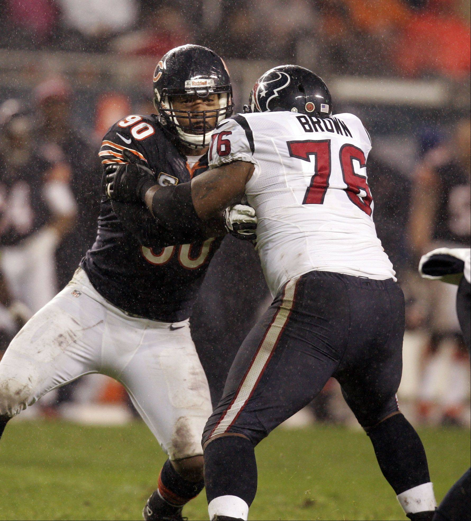 Chicago Bears defensive end Julius Peppers (90) battles with Houston Texans tackle Duane Brown (76) during the game Sunday November 11, 2012 at Soldier Field in Chicago.