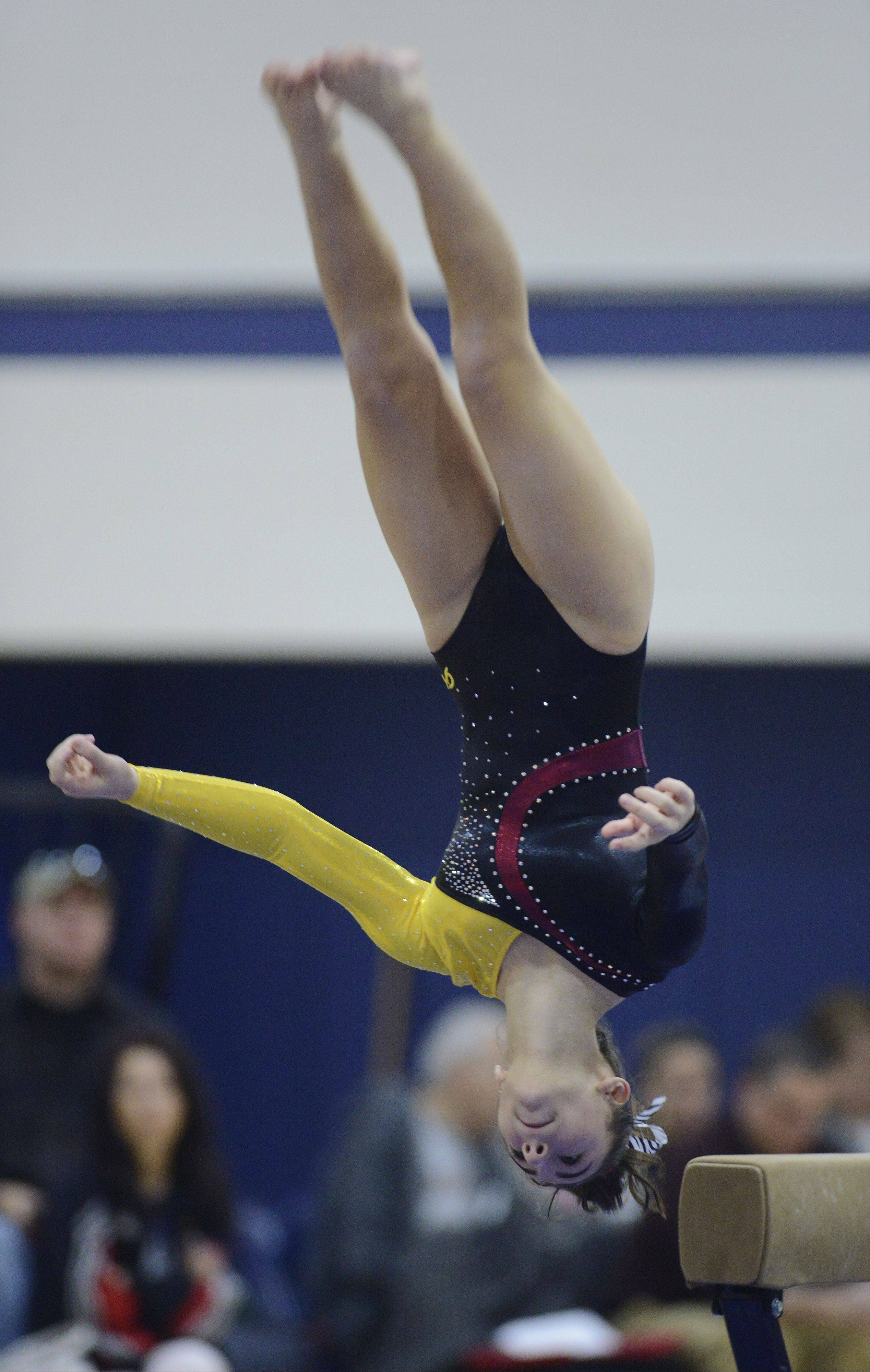 Schaumburg's Samantha Panther dismounts from the balance beam during the Conant girls gymnastics invite Saturday.