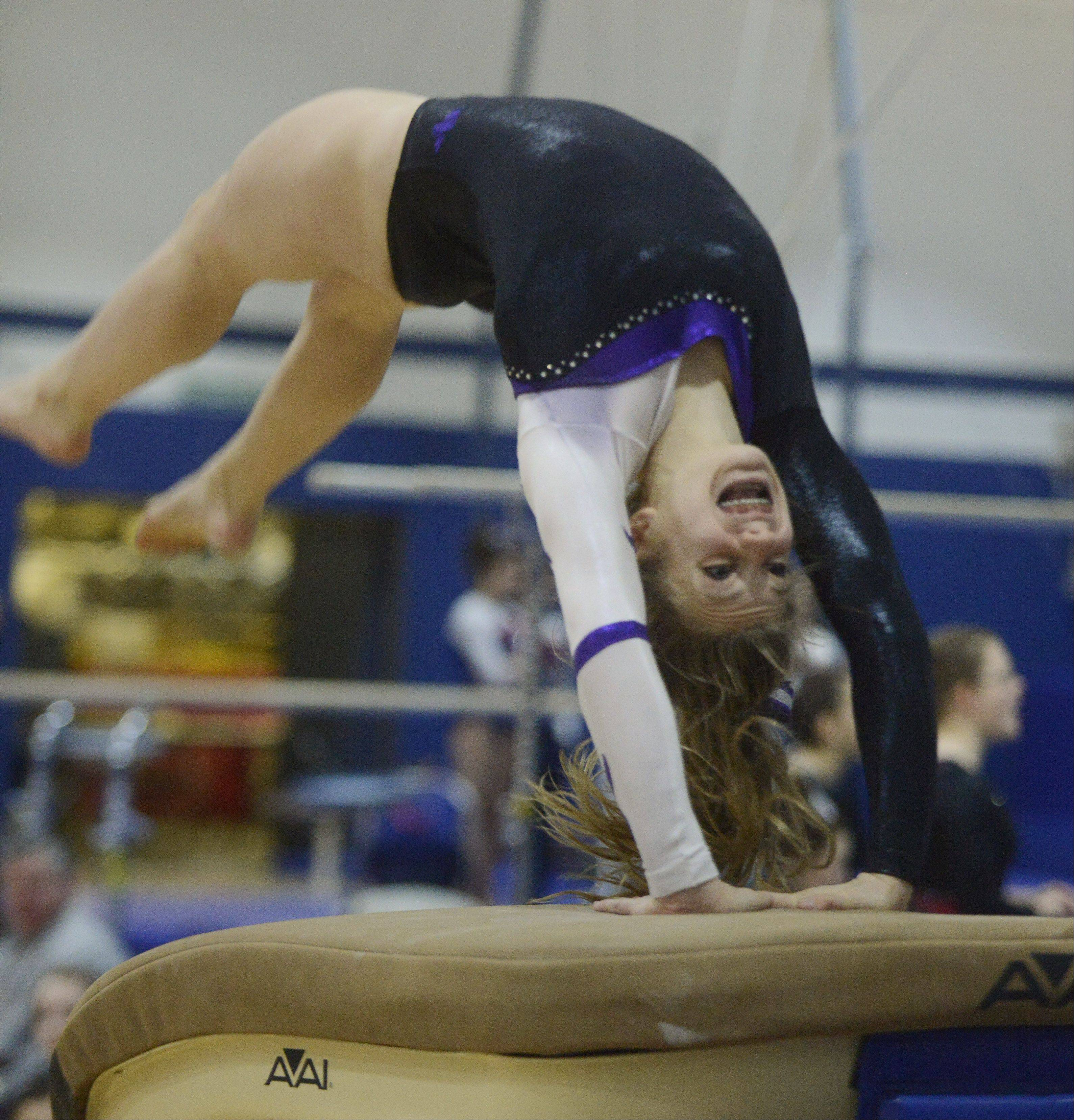 Lenna Klein of Wheaton Warrenville South competes on the vault during the Conant girls gymnastics invite Saturday.