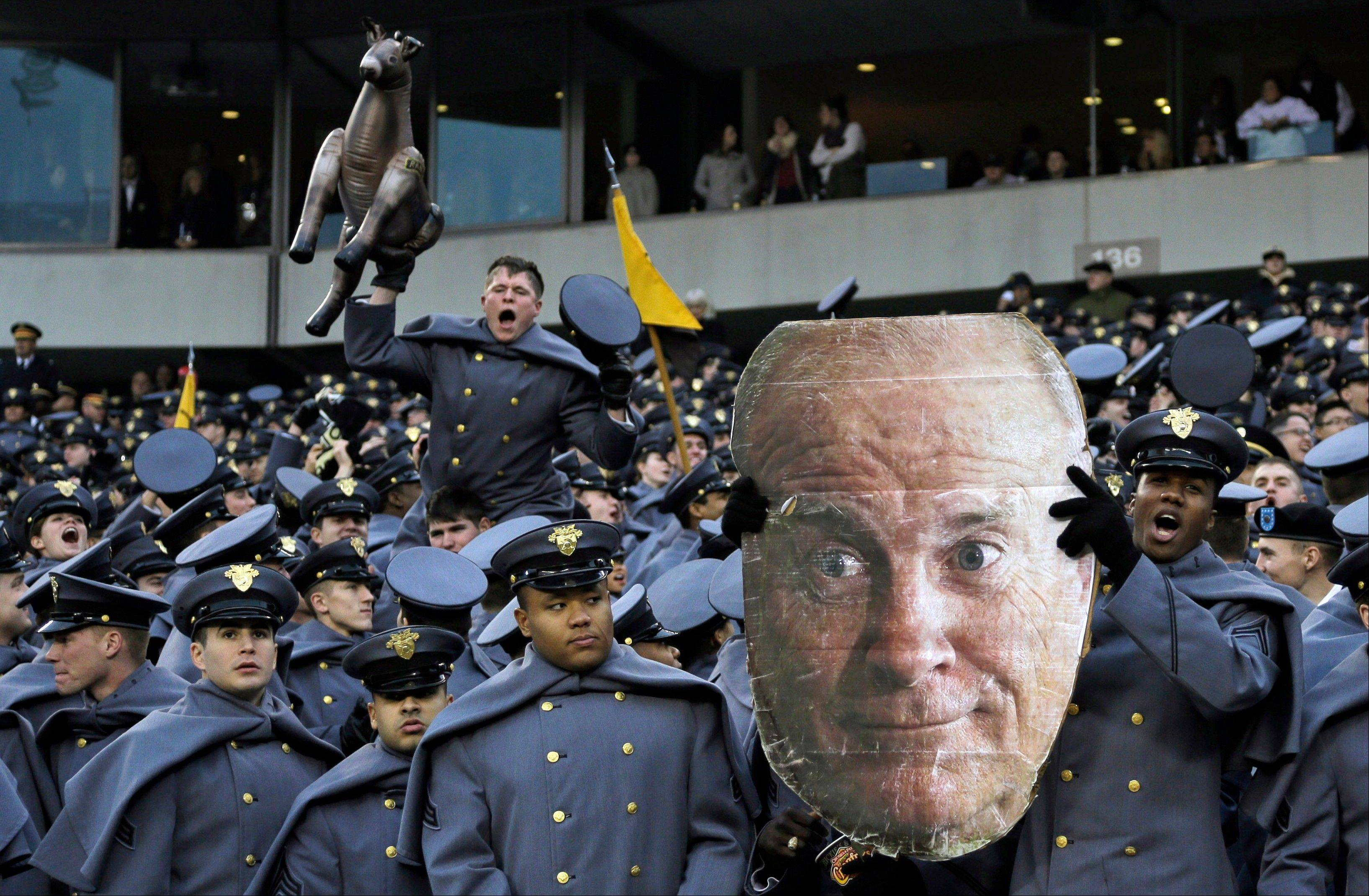 Army Cadets cheer and hold an image Vice President Joe Biden during the first half in Philadelphia.