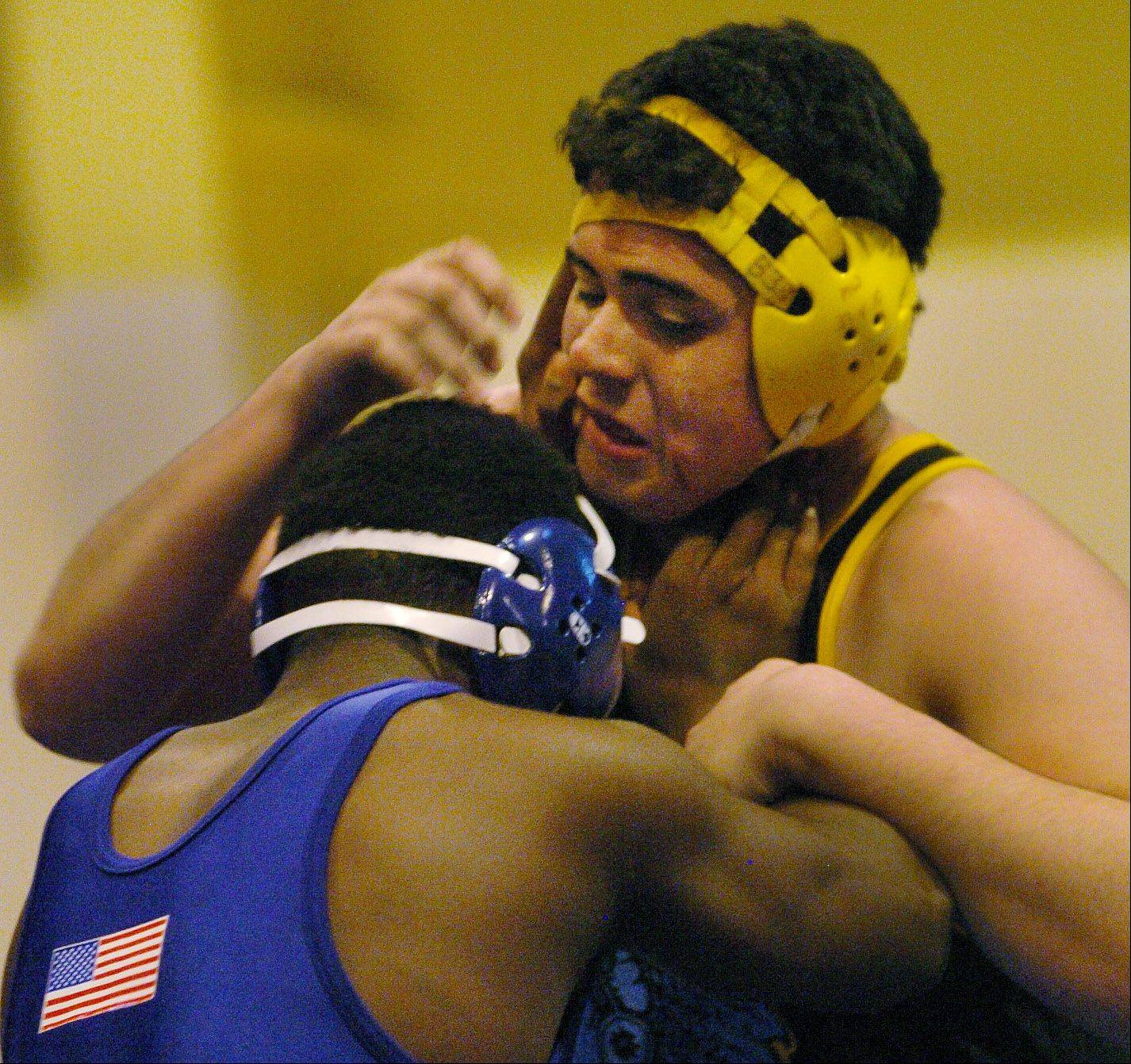 Jamie Marquez of Maine West, right, falls in his match to Sandburg's Robert Boyde in the 285-pound class Saturday at the Wheeling invite.