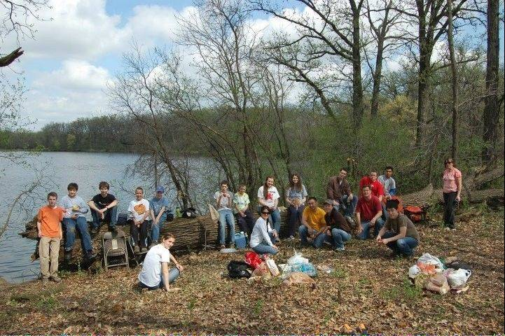 Volunteers of Mark Rapala's island restoration project take a well deserved break in Busse Woods.