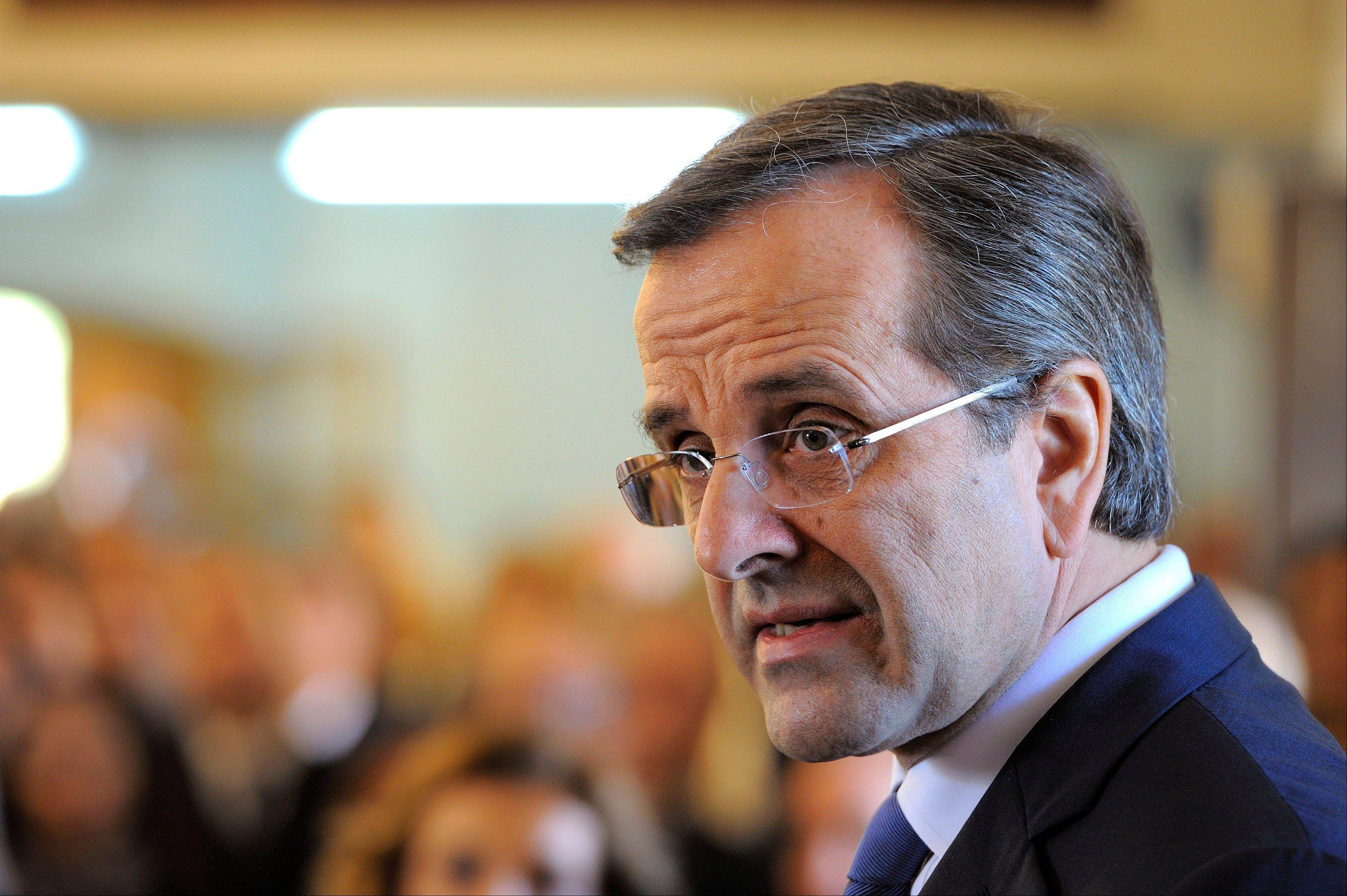 Greek Prime Minister Antonis Samaras speaks at a memorial service for Cyprus� late President Tassos Papadopoulos near the island�s capital, Nicosia, Sunday. Samaras is in Cyprus for two-day unofficial visit.