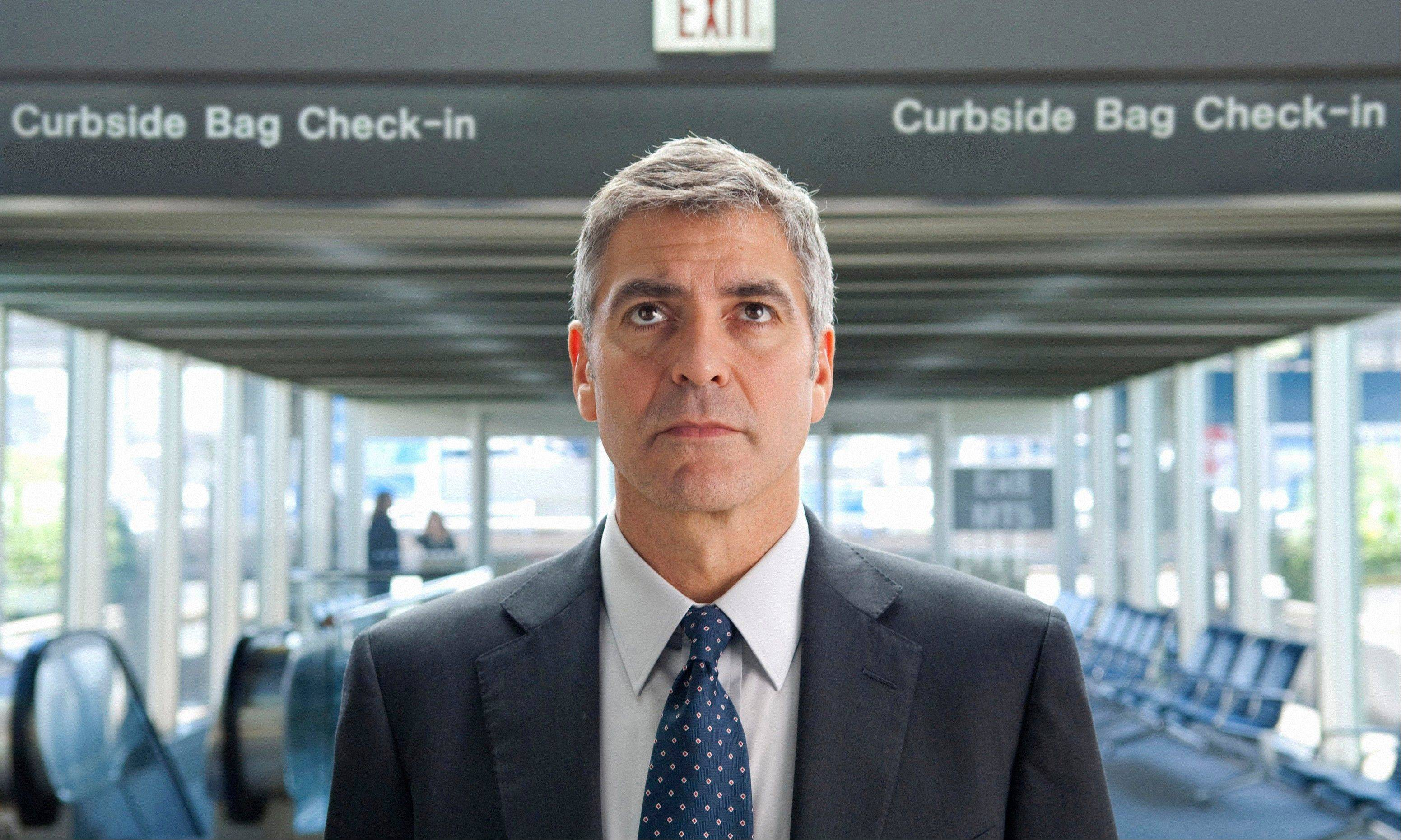 "George Clooney portrays Ryan Bingham in ""Up in the Air."""