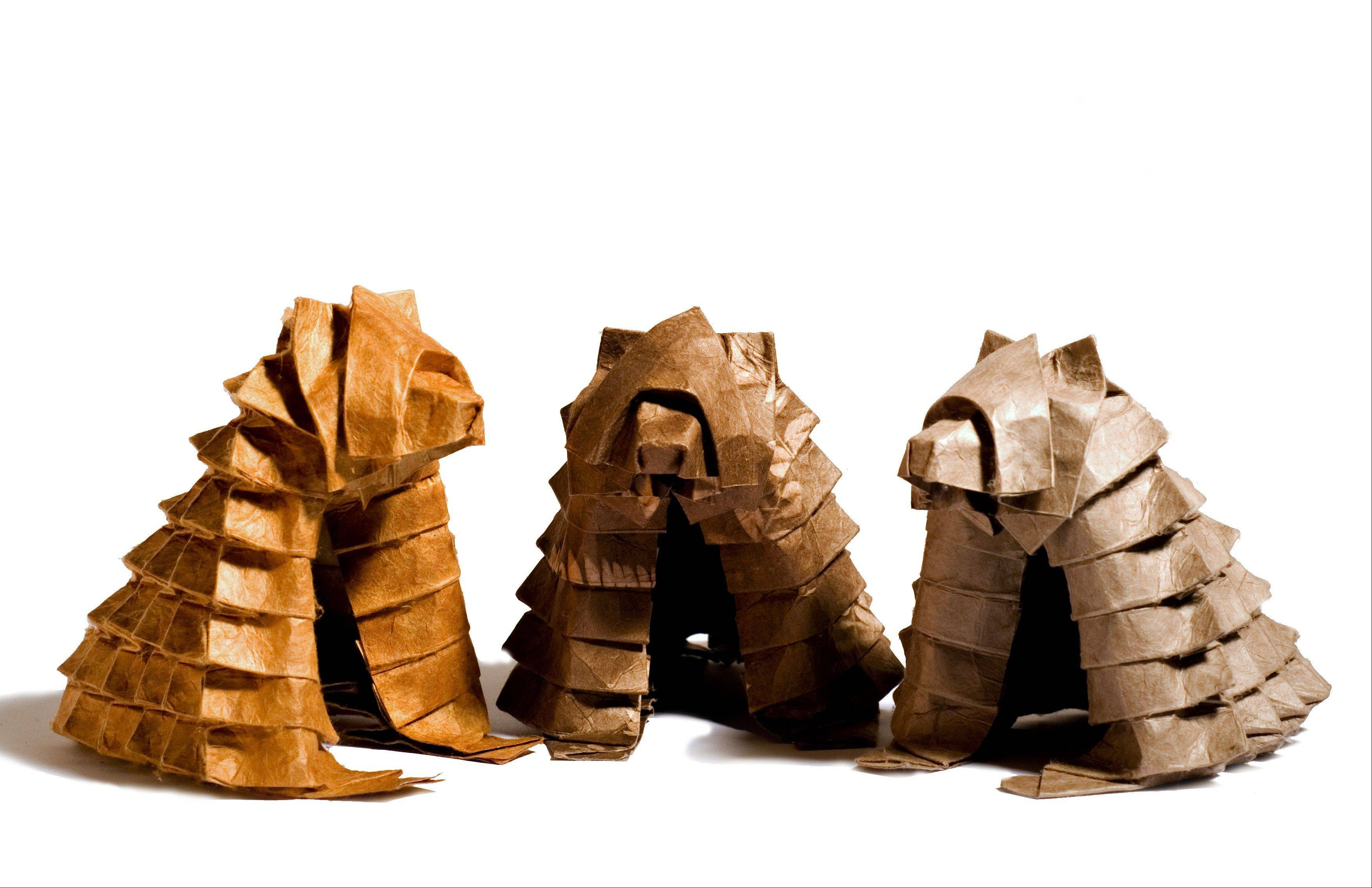 Origami artist Beth Johnson designed these origami bears folded from a single sheet of paper with cuts or glue.