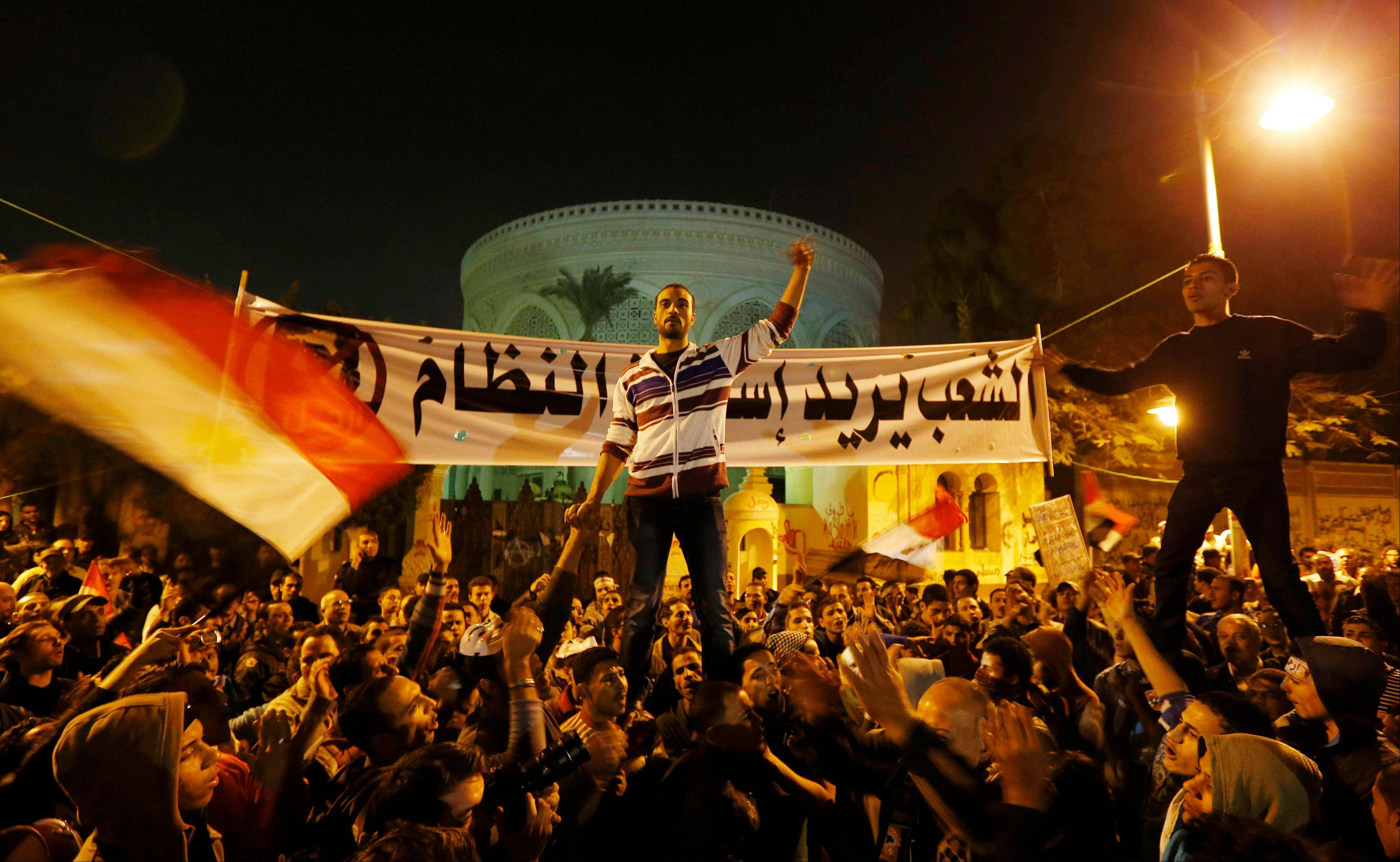 Protesters chant slogans during a demonstration in front of the presidential palace in Cairo on Egypt Sunday. Egypt�s liberal opposition called for more protests Sunday.