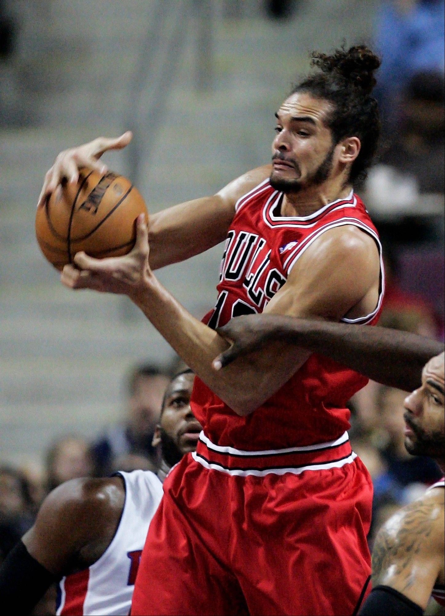 Bulls center Joakim Noah grabs one of his career-high 23 rebounds in Friday�s victory at Detroit. He also scored a career-high 30 points.