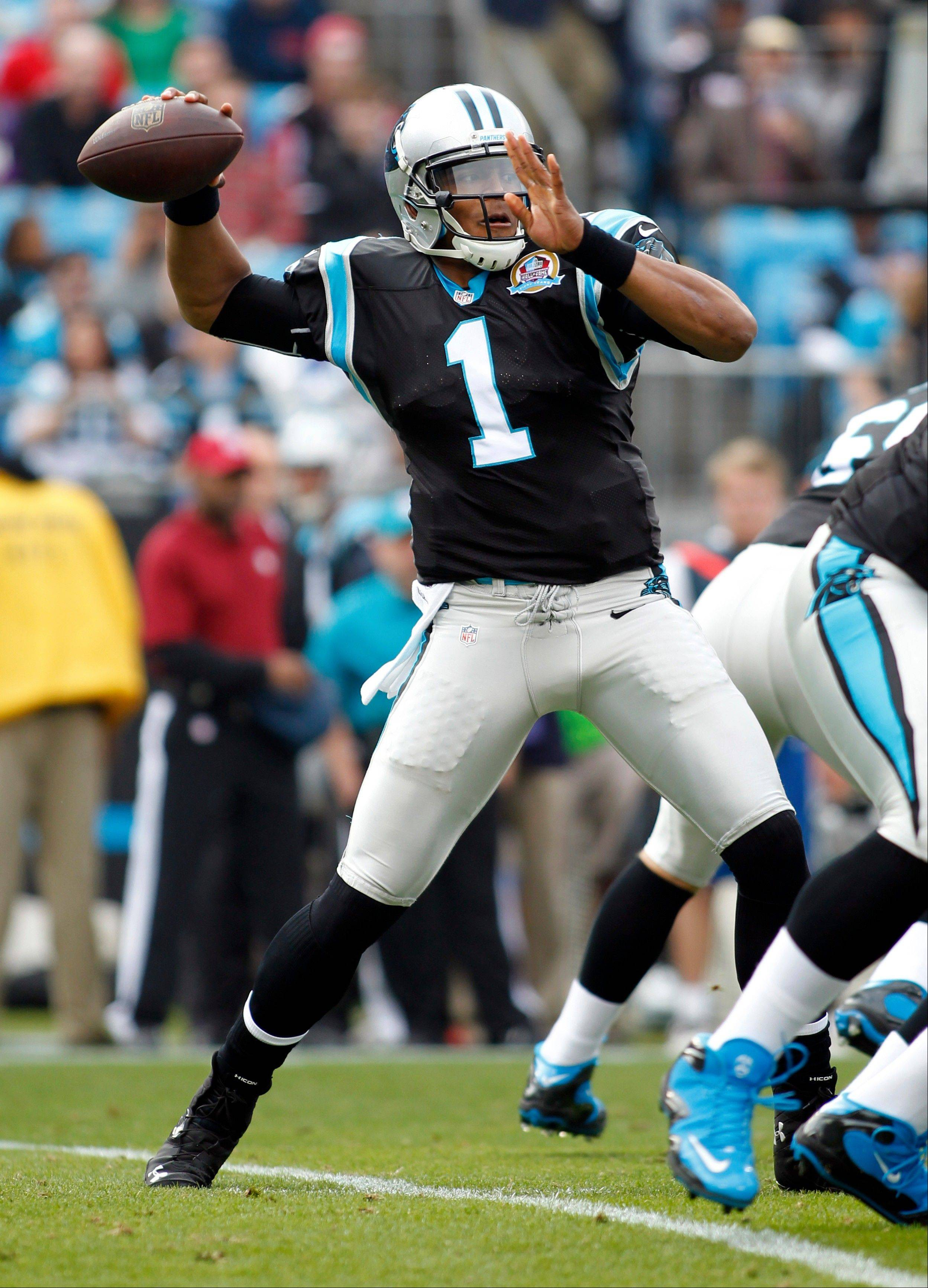 Carolina Panthers quarterback Cam Newton looks to pass against the Atlanta Falcons during the first half of an NFL football game in Charlotte, N.C., Sunday, Dec. 9, 2012.