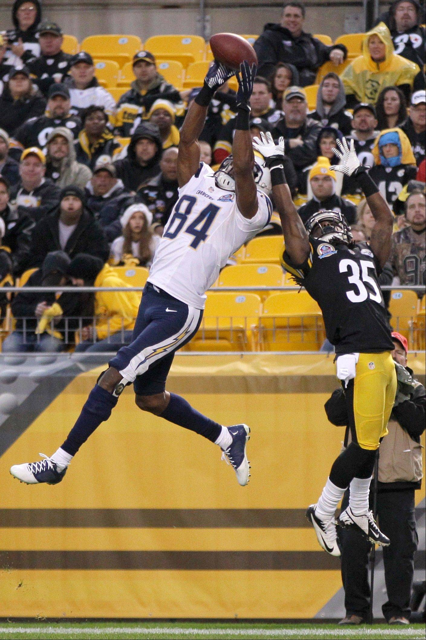 San Diego Chargers wide receiver Danario Alexander (84) goes up to make a touchdown catch in front of Pittsburgh Steelers defensive back Josh Victorian in the fourth quarter of an NFL football game in Pittsburgh, Sunday, Dec. 9, 2012.