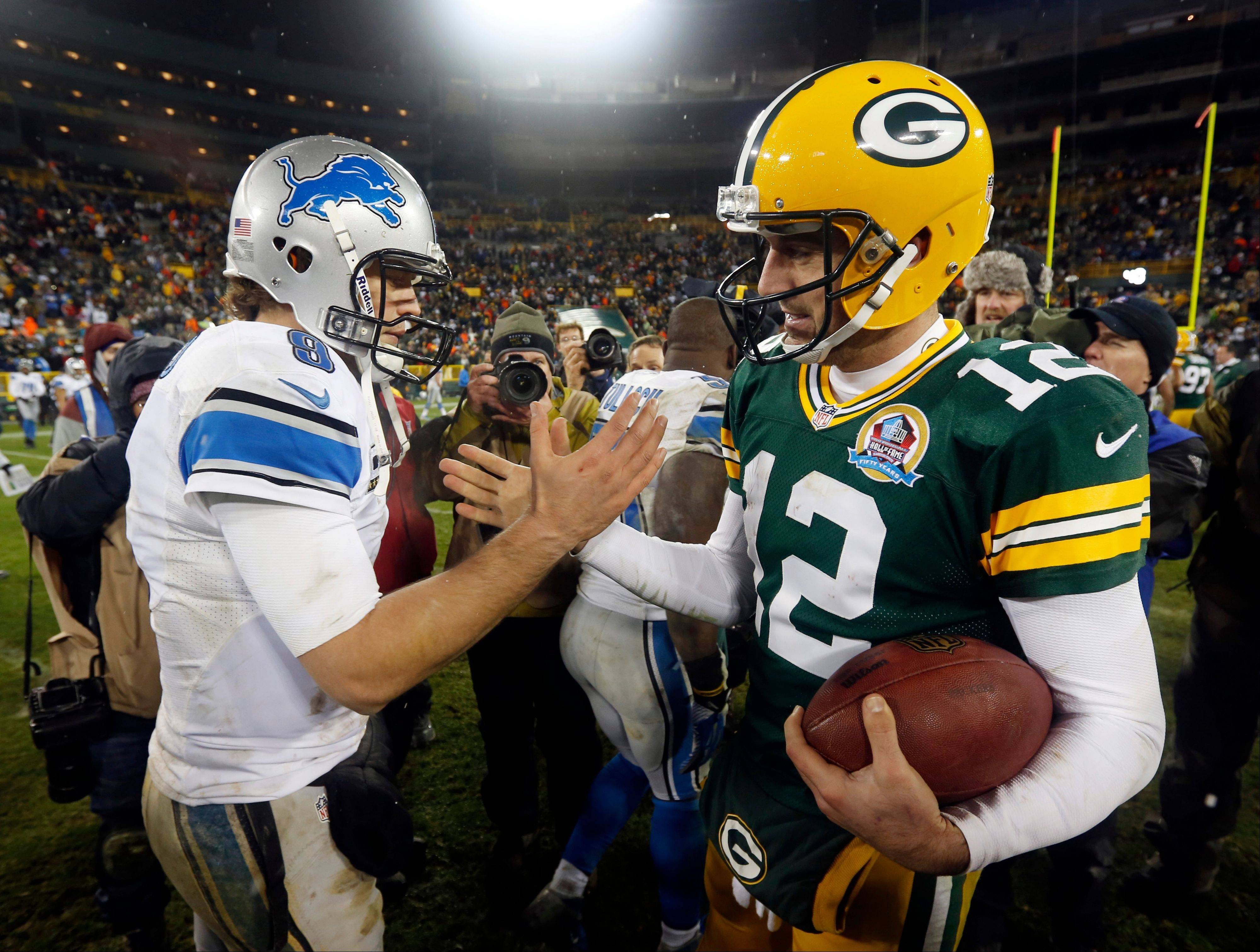 Green Bay Packers quarterback Aaron Rodgers shakes hands with Detroit Lions quarterback Matthew Stafford after the Packers� victory Sunday at Lambeau Field.
