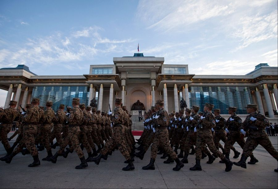 Mongolian soldiers take part in a rehearsal for a military parade during the Naadam Festival in front of Parliament on the Sukhbaatar Square in Ulan Bator, Mongolia. Landlocked with 2.8 million people spread over an area twice the size of Texas, Mongolia is dwarfed by China, with its 1.3 billion people and the world's second largest economy. Fully 90 percent of Mongolia's exports -- coal, copper, cashmere and livestock -- go to China, which in turn sends machinery, appliances and other consumer goods that account for a third of Mongolian imports.