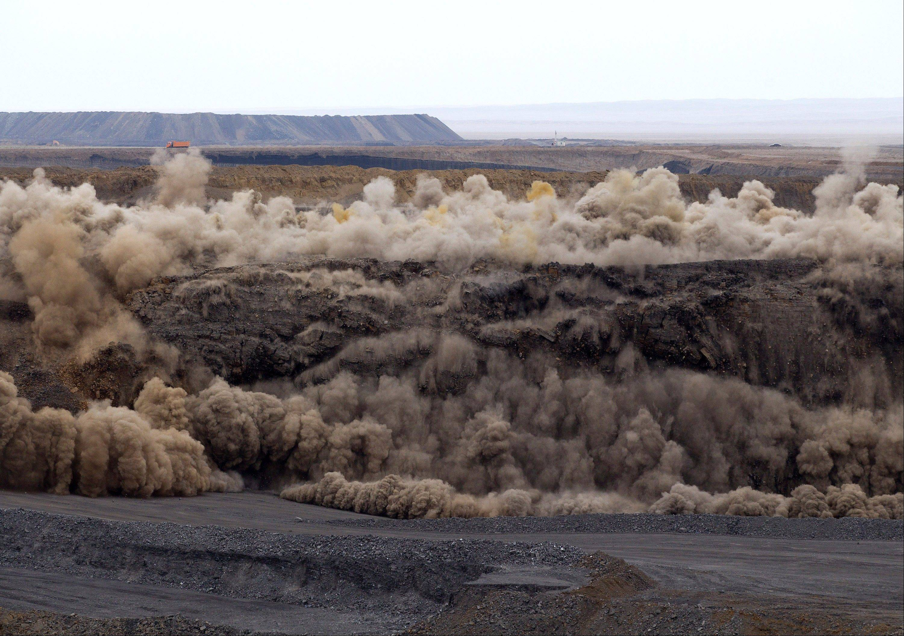 Miners use explosives to blast a section of the Erdenes Tavan Tolgoi coal mine in Tavan Tolgoi, southern Mongolia.