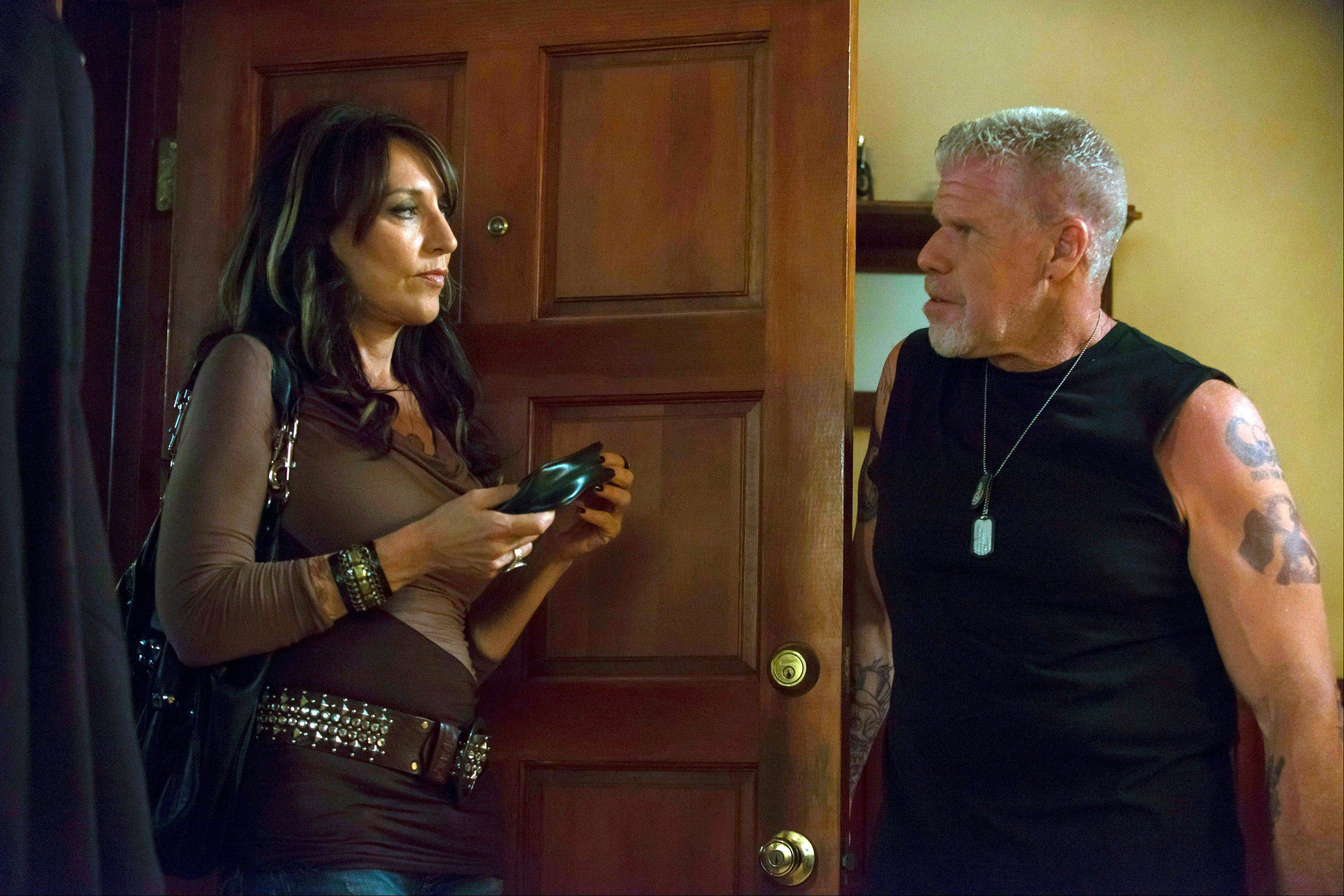 "Gemma (Katey Sagal) and Clay (Ron Perlman) live dangerous lives, always on alert, in FX's ""Sons of Anarchy."""