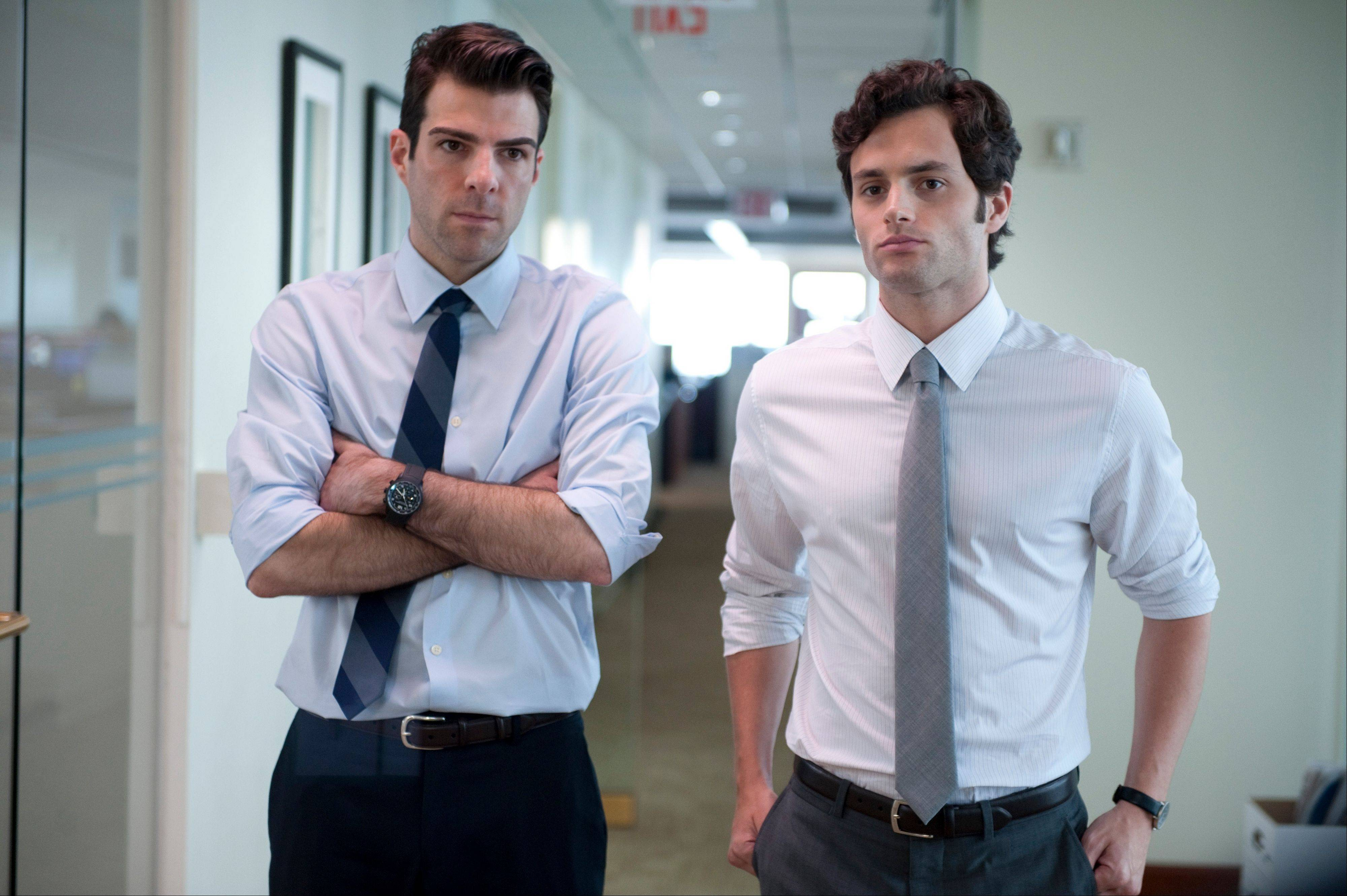 "Zachary Quinto, left, and Penn Badgley in a scene from ""Margin Call."""