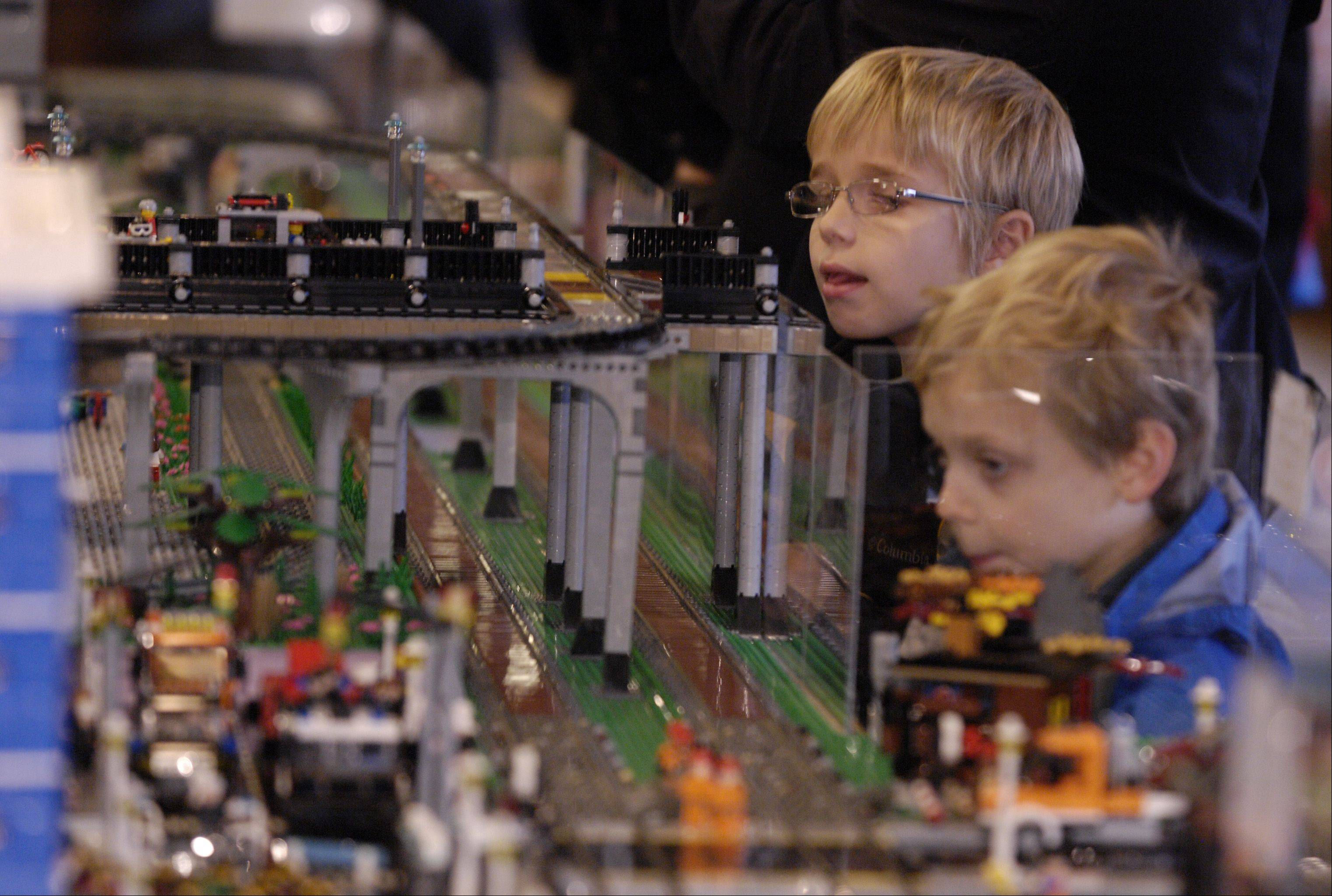 Jude Fredericks, 9, and his brother, Eden, 7, of Glen Ellyn, check out the Lego train displays at Cantigny Park's annual Holiday Lego Train Show in Wheaton Sunday.